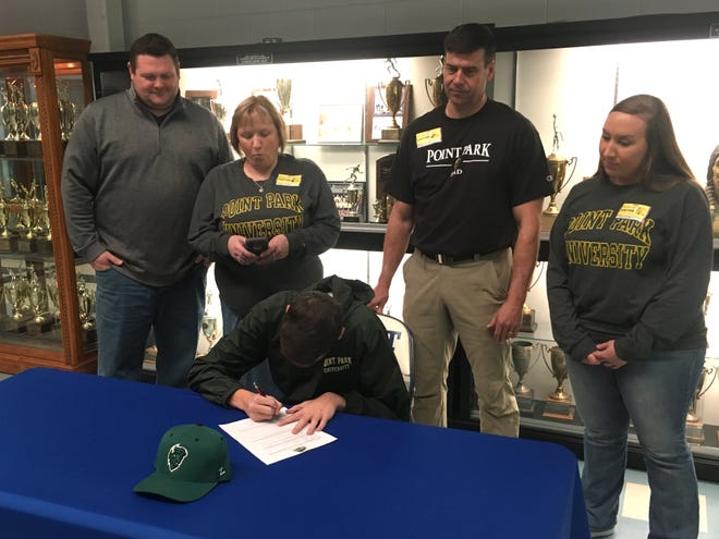 Tyler Pullin, a Fort Defiance senior, signed a grant-in-aid form Friday to play baseball for Point Park University.