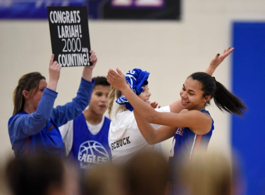 Lariah Washington is congratulated for scoring 2,000 points before the start of the Thursday, Jan. 17, game against ROCORI at Apollo High School in St. Cloud.