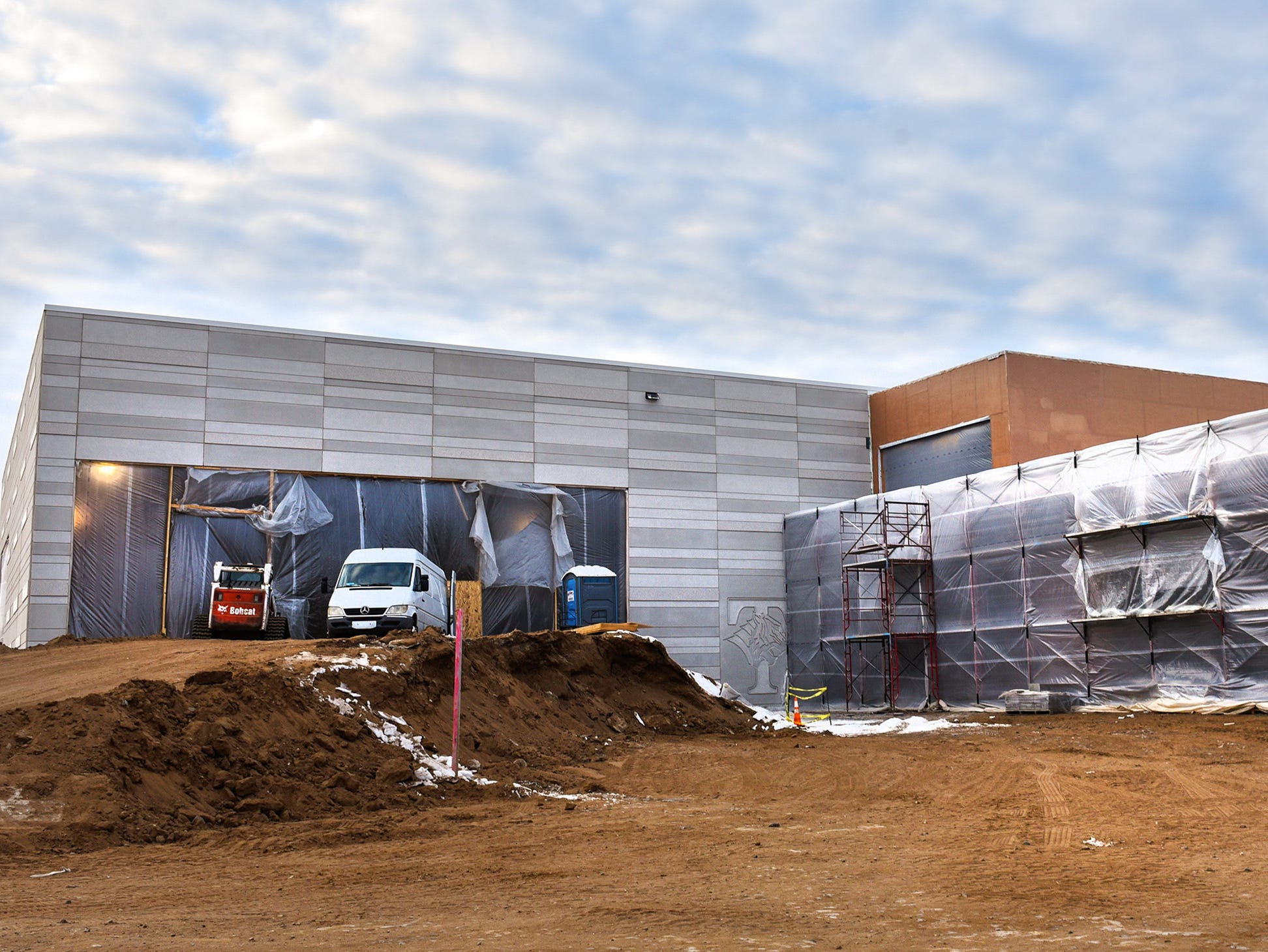 The pool, left, and the activities entrance under construction Thursday, Jan. 17, at the new Tech High School.