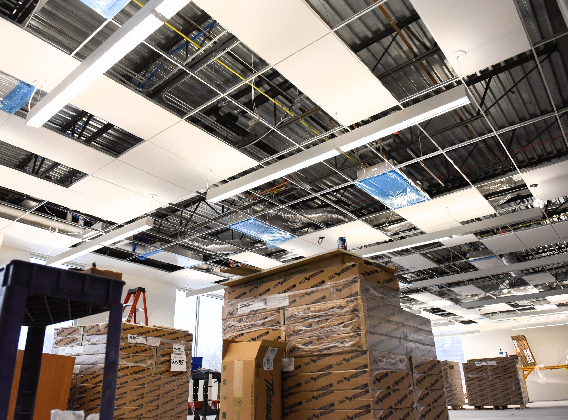 LED lighting and ceiling tiles are being installed in learning neighborhood 1 Thursday, Jan. 17, at the new Tech High School.