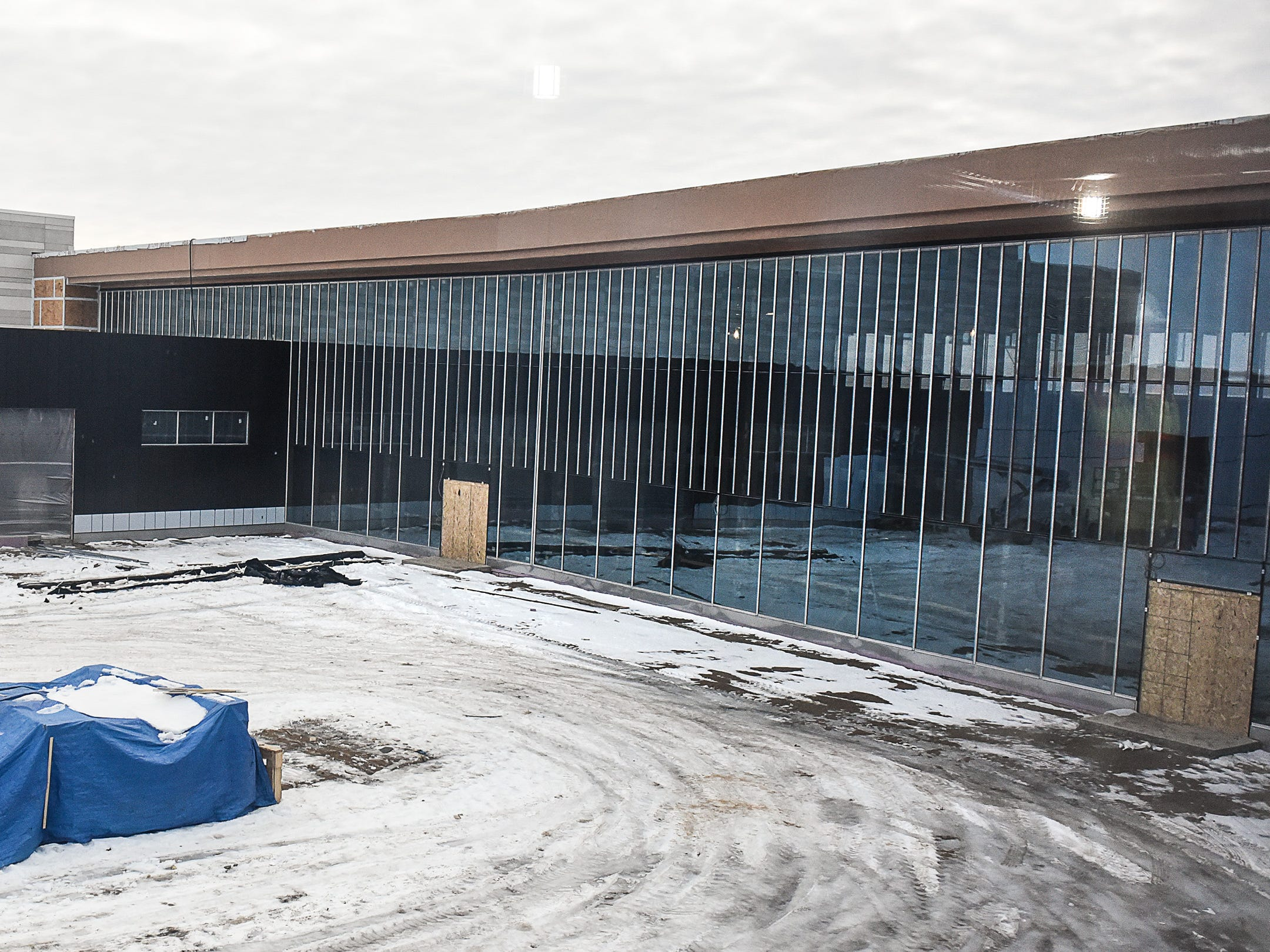 The glass wall of the commons area shown  Thursday, Jan. 17, at the new Tech High School.