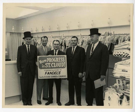 Top-hatters deliver a progress award to Fandel's in this vintage photo.