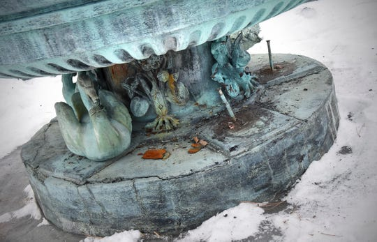 Bronze figures are missing and damage is visible on the Windsor Court Fountain at Clemens Gardens Friday, Jan. 18, in St. Cloud.