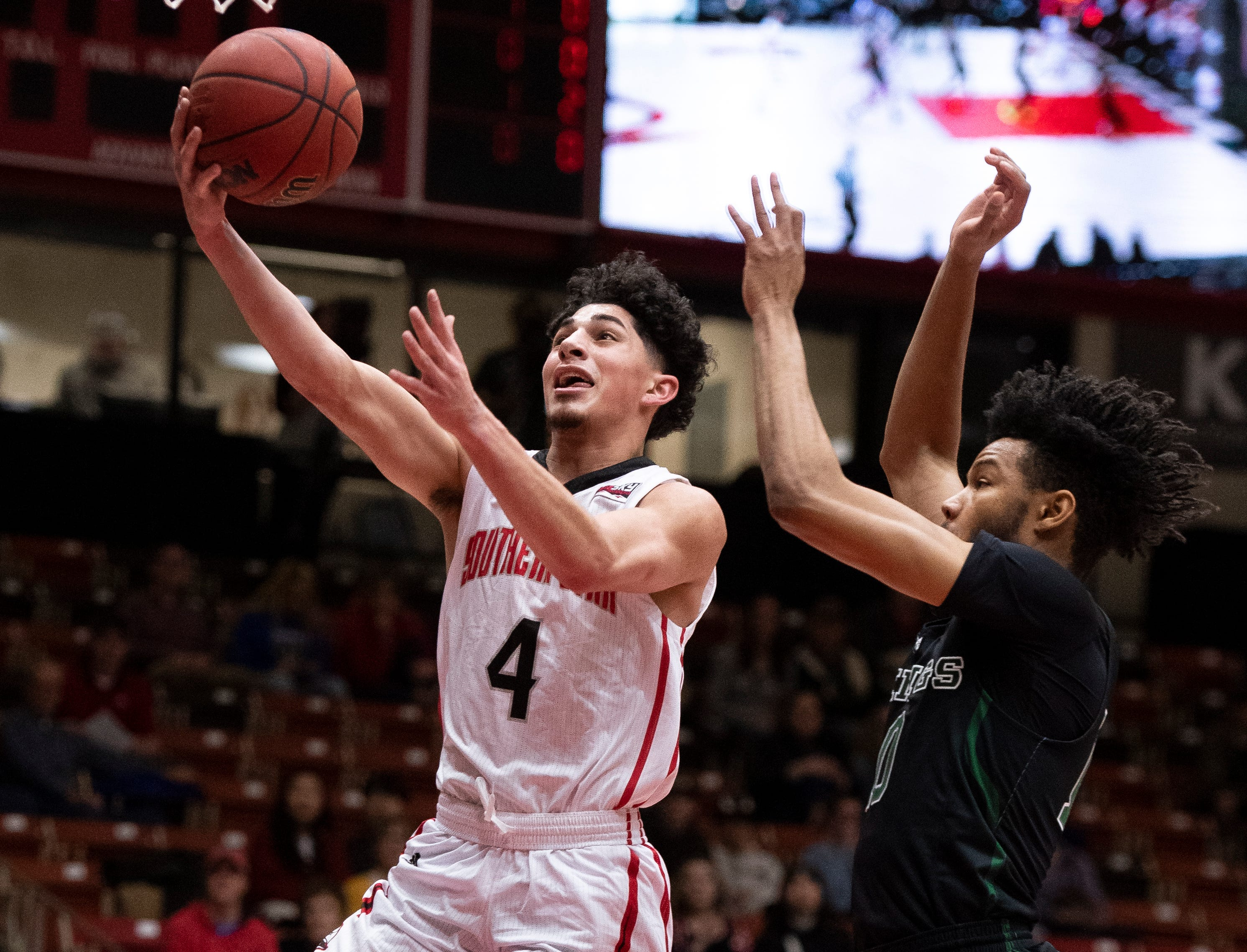 Southern Utah University sophomore Dre Marin (4) scores a basket against Portland State in the America First Event Center Thursday, January 17, 2019. SUU won, 83-69.