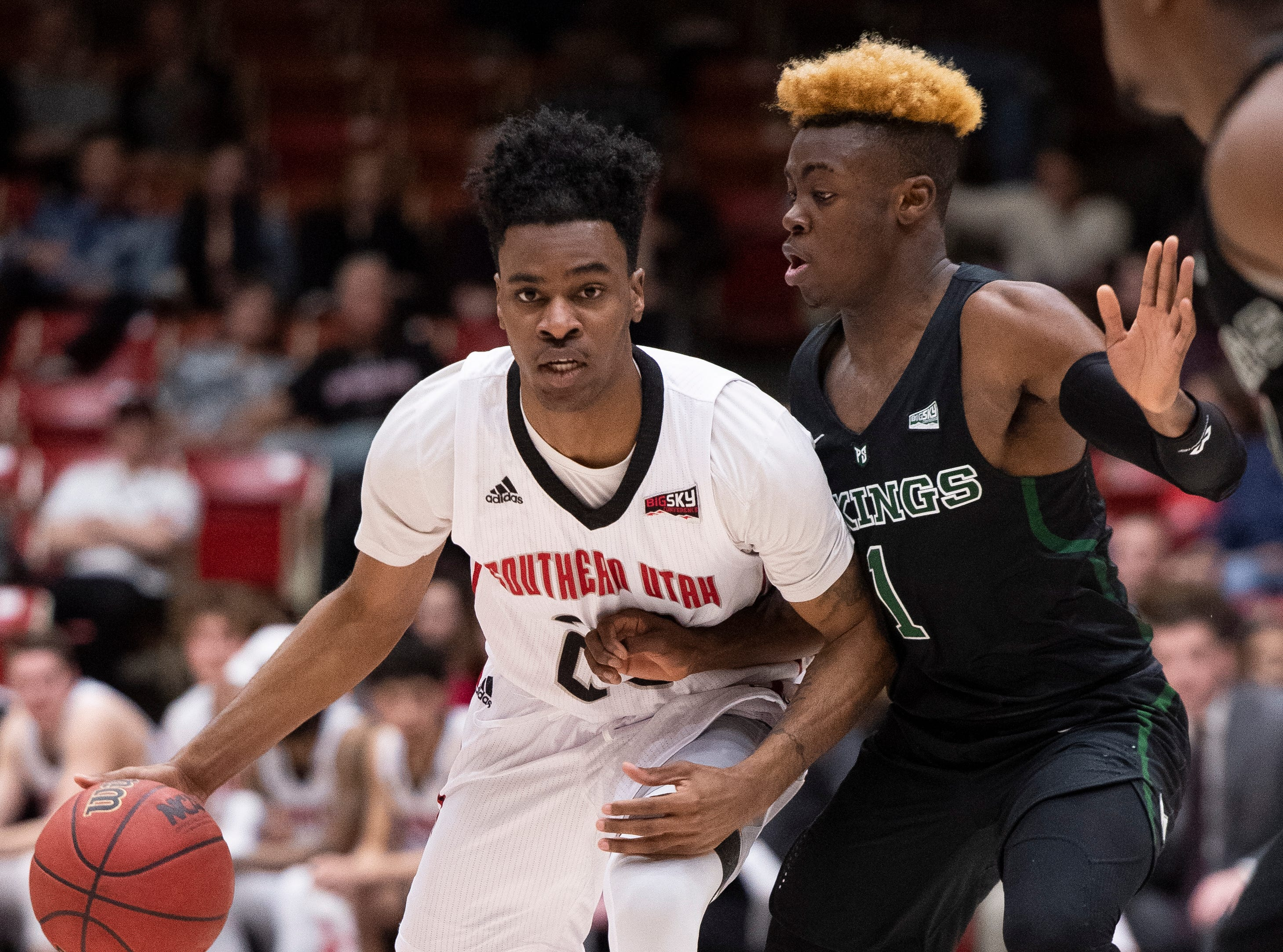 Southern Utah University junior Cameron Oluyitan (23) tries to find room against Portland State in the America First Event Center Thursday, January 17, 2019. SUU won, 83-69.