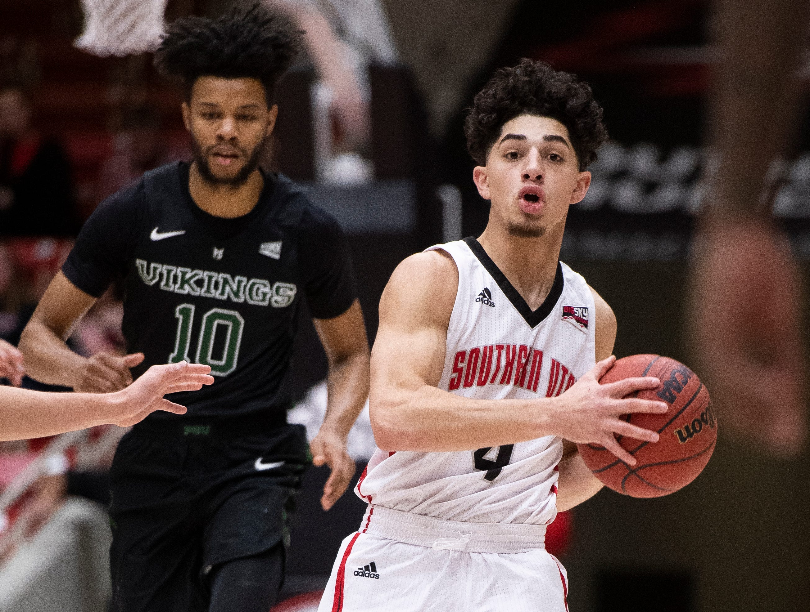 Southern Utah University sophomore Dre Marin (4) moves the ball against Portland State in the America First Event Center Thursday, January 17, 2019. SUU won, 83-69.