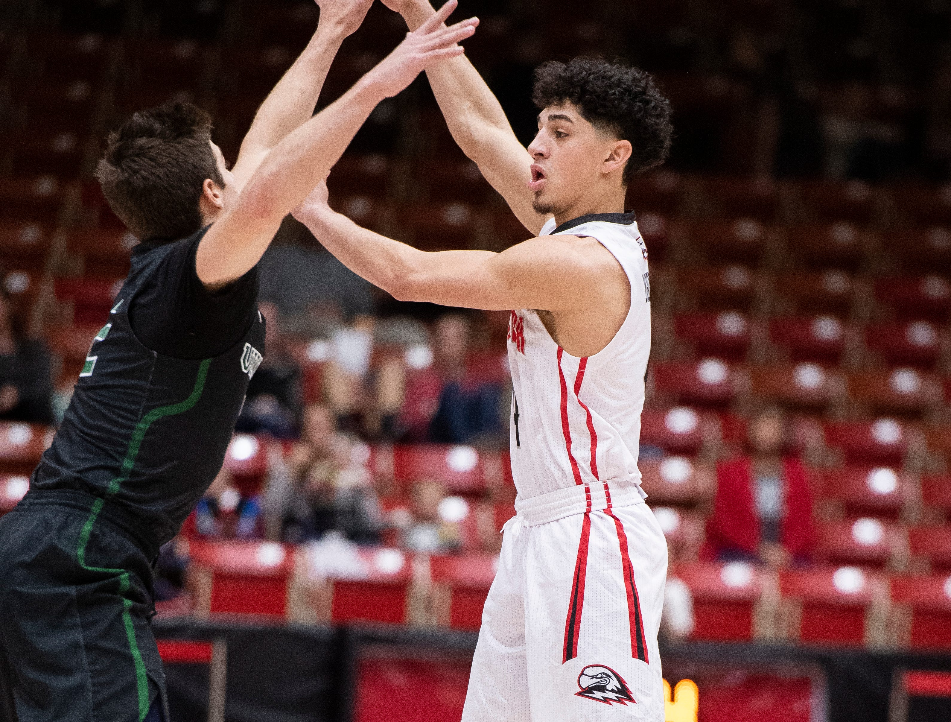Southern Utah University sophomore Dre Marin (4) throws a pass against Portland State in the America First Event Center Thursday, January 17, 2019. SUU won, 83-69.