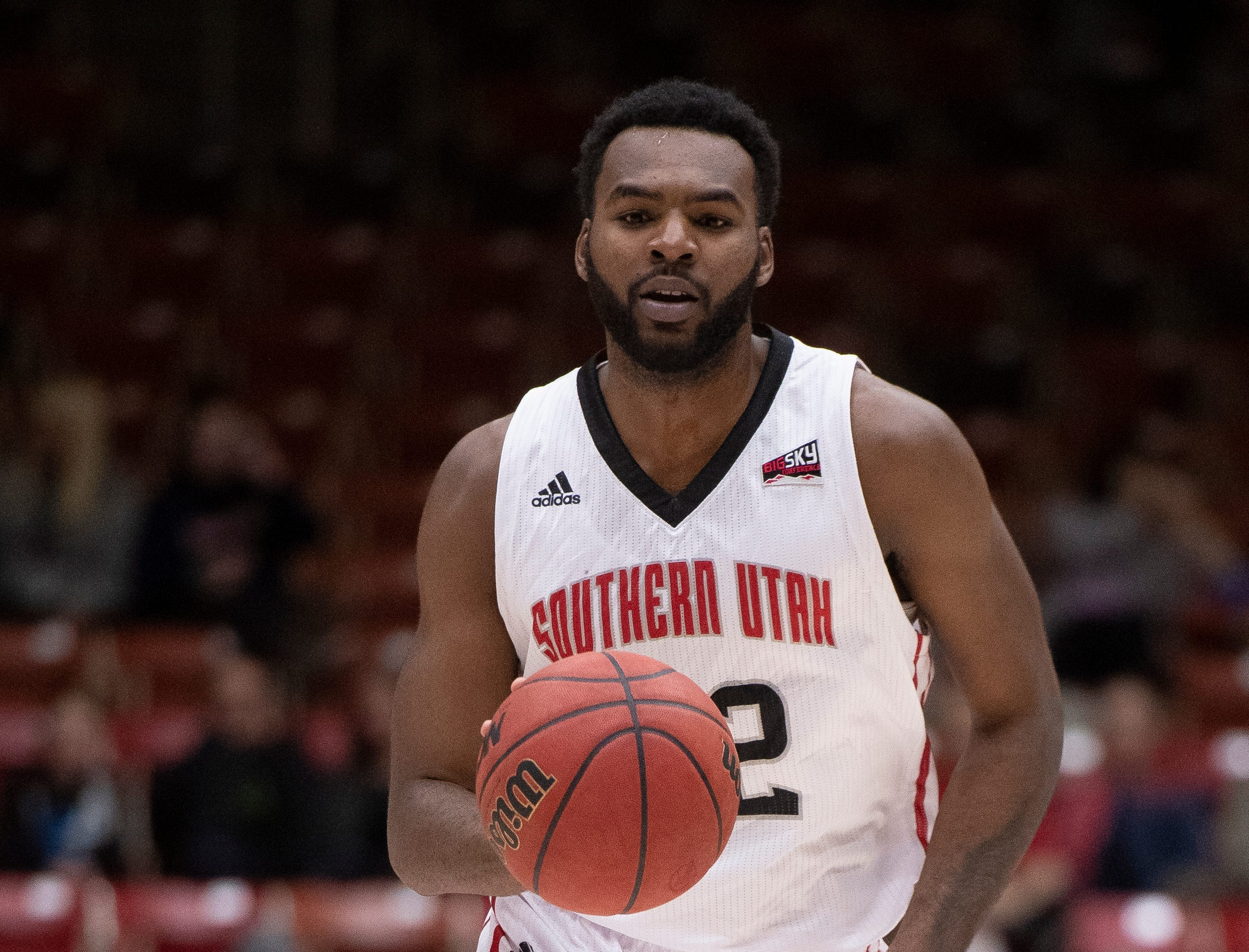 Southern Utah University junior Andre Adams (32) moves the ball against Portland State in the America First Event Center Thursday, January 17, 2019. SUU won, 83-69.
