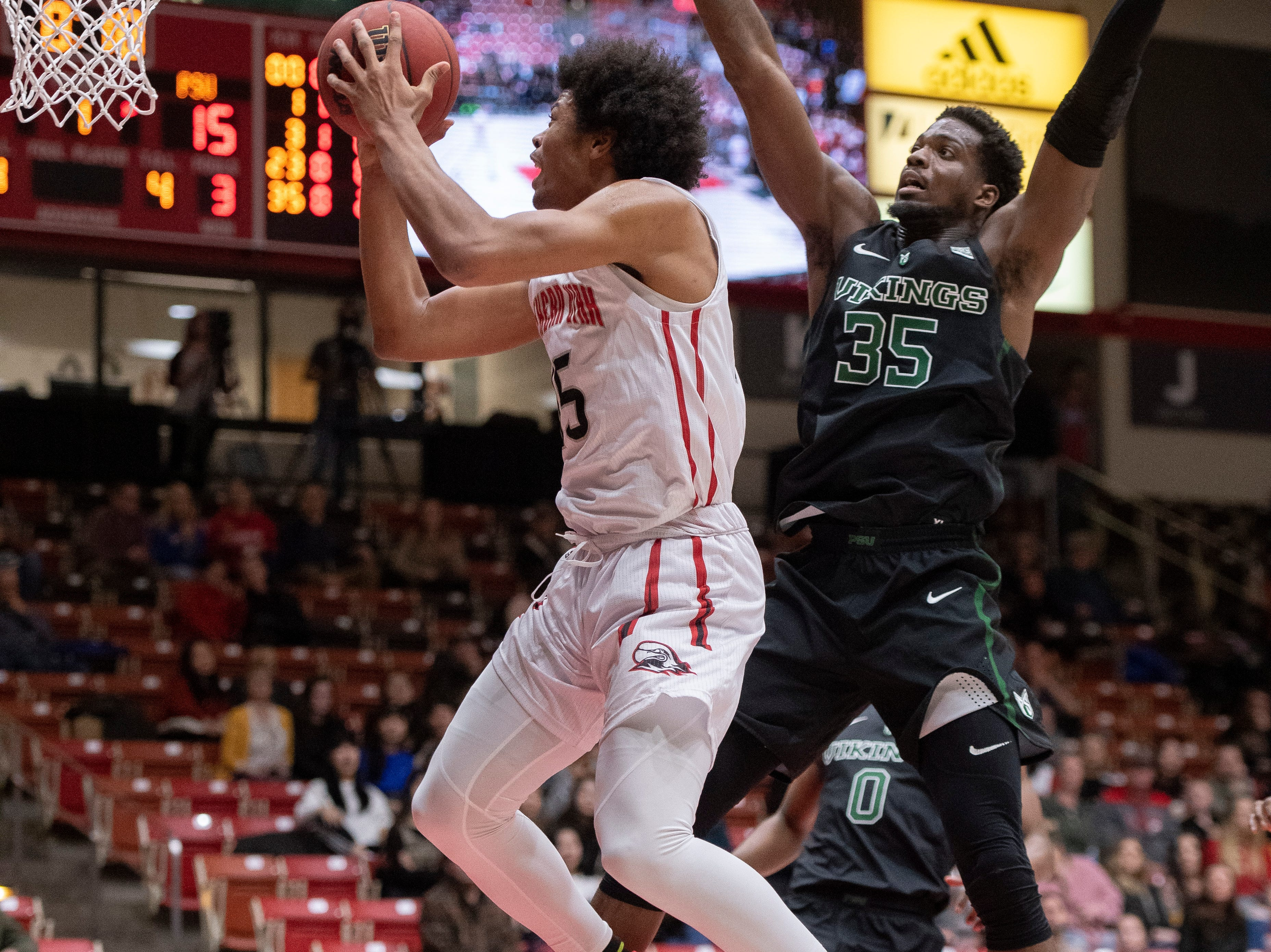Southern Utah University freshman Harrison Butler (15) scores against Portland State in the America First Event Center Thursday, January 17, 2019. SUU won, 83-69.