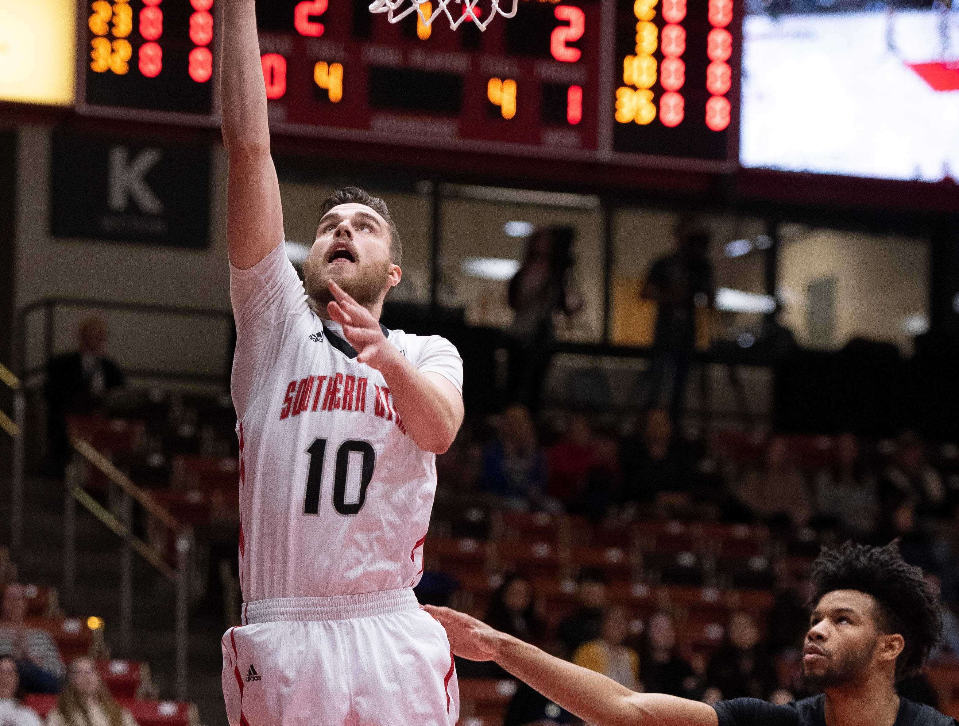 Southern Utah University junior Jacob Calloway (10) scores a basket against Portland State in the America First Event Center Thursday, January 17, 2019. SUU won, 83-69.