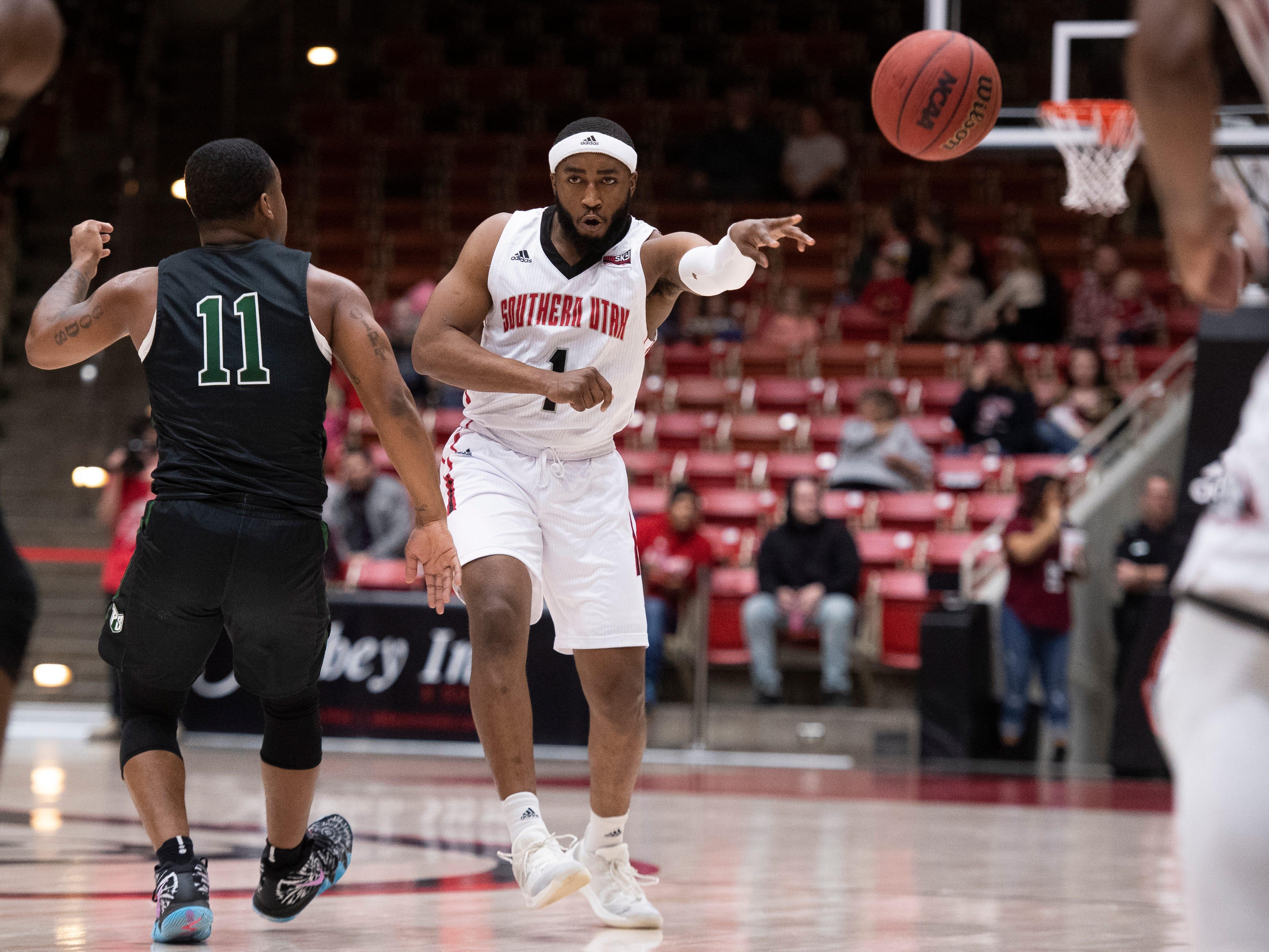 Southern Utah University freshman Kenton Eskridge (1) throws a pass against Portland State in the America First Event Center Thursday, January 17, 2019. SUU won, 83-69.