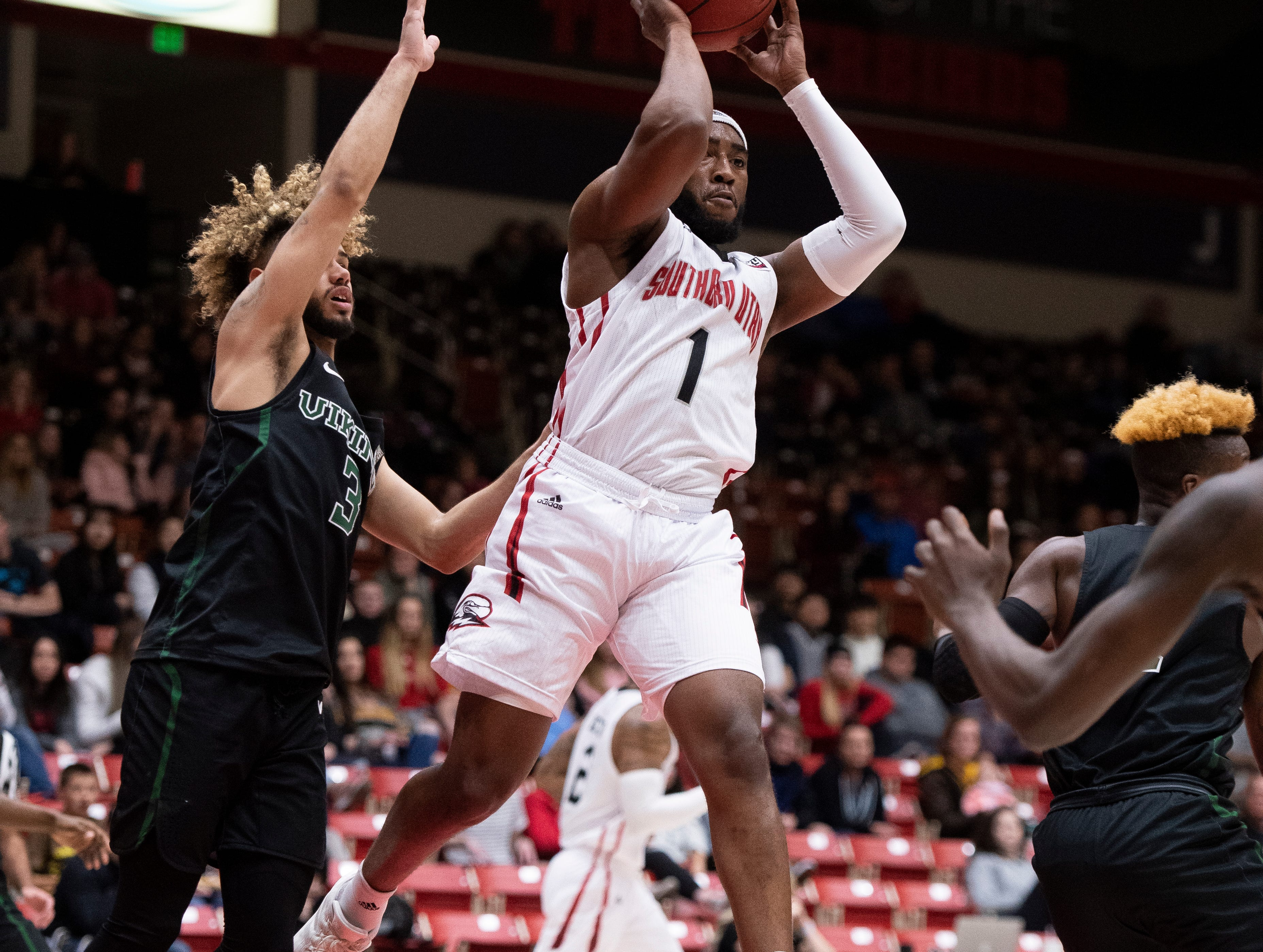 Southern Utah University freshman Kenton Eskridge (1) throws a flying pass against Portland State in the America First Event Center Thursday, January 17, 2019. SUU won, 83-69.
