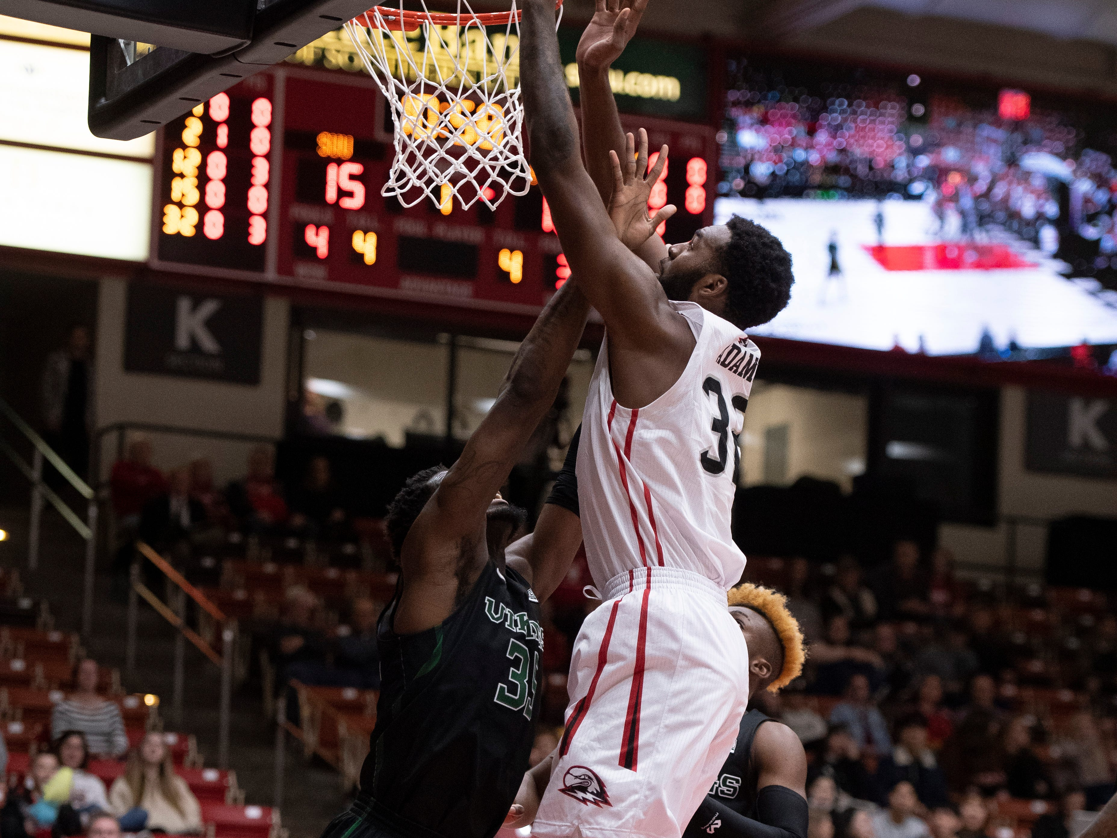 Southern Utah University junior Andre Adams (32) shoots over a Portland State defender in the America First Event Center Thursday, January 17, 2019. SUU won, 83-69.