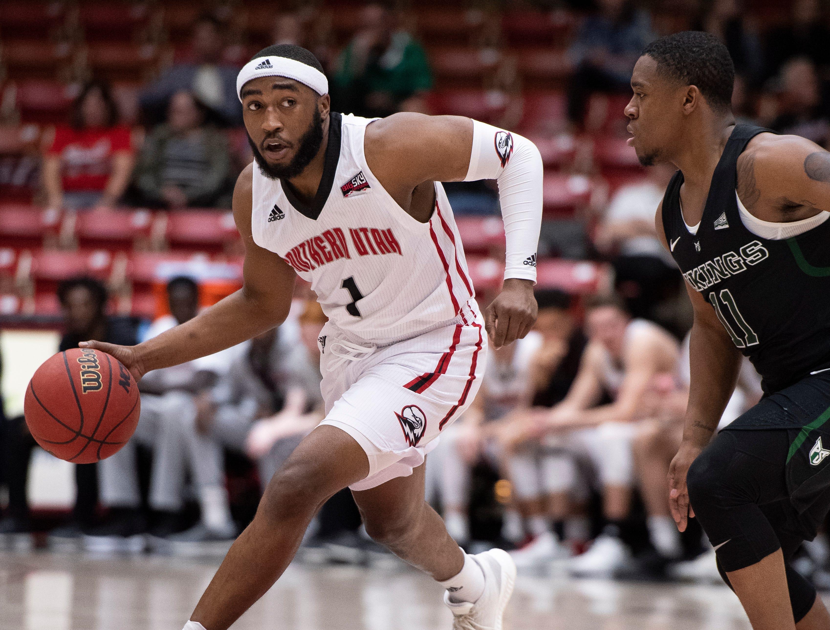 Southern Utah University freshman Kenton Eskridge (1) moves the ball against Portland State in the America First Event Center Thursday, January 17, 2019. SUU won, 83-69.