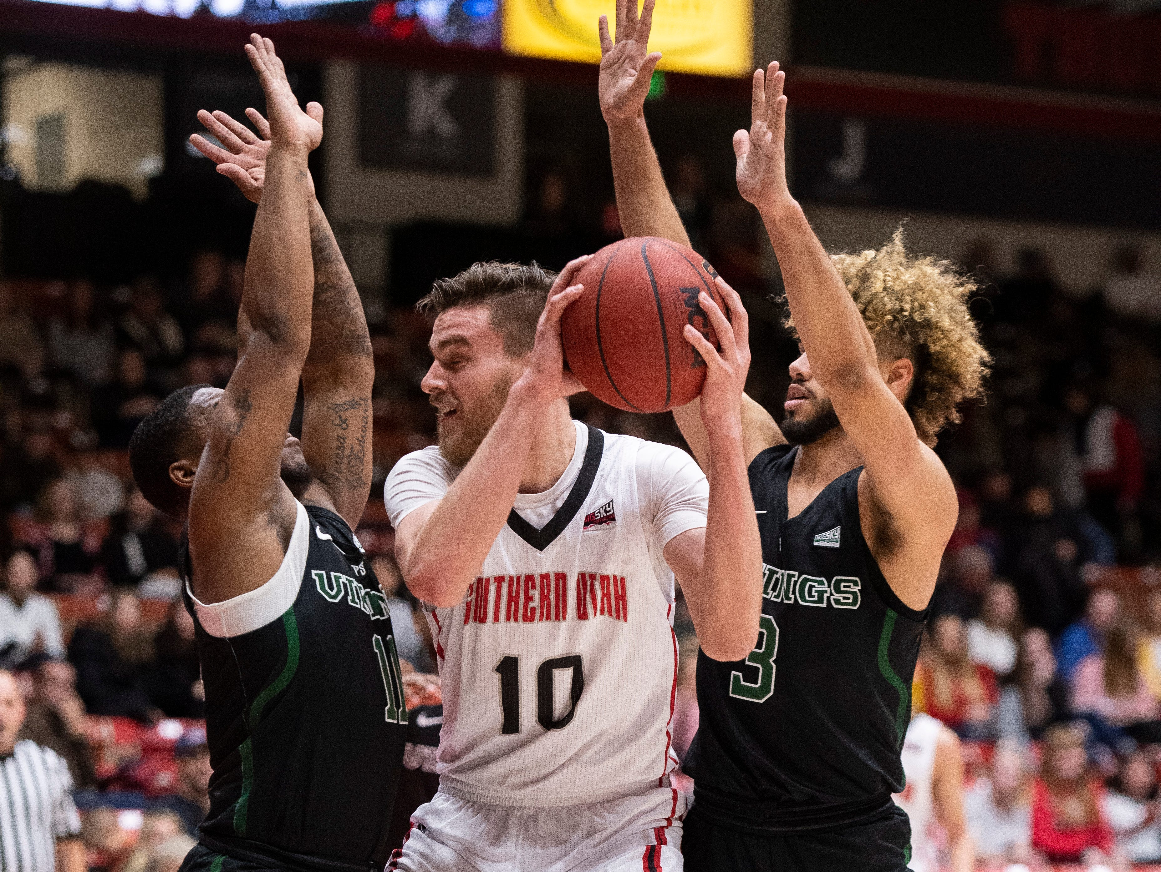 Southern Utah University junior Jacob Calloway (10) feels crowded by the Portland State defense in the America First Event Center Thursday, January 17, 2019. SUU won, 83-69.