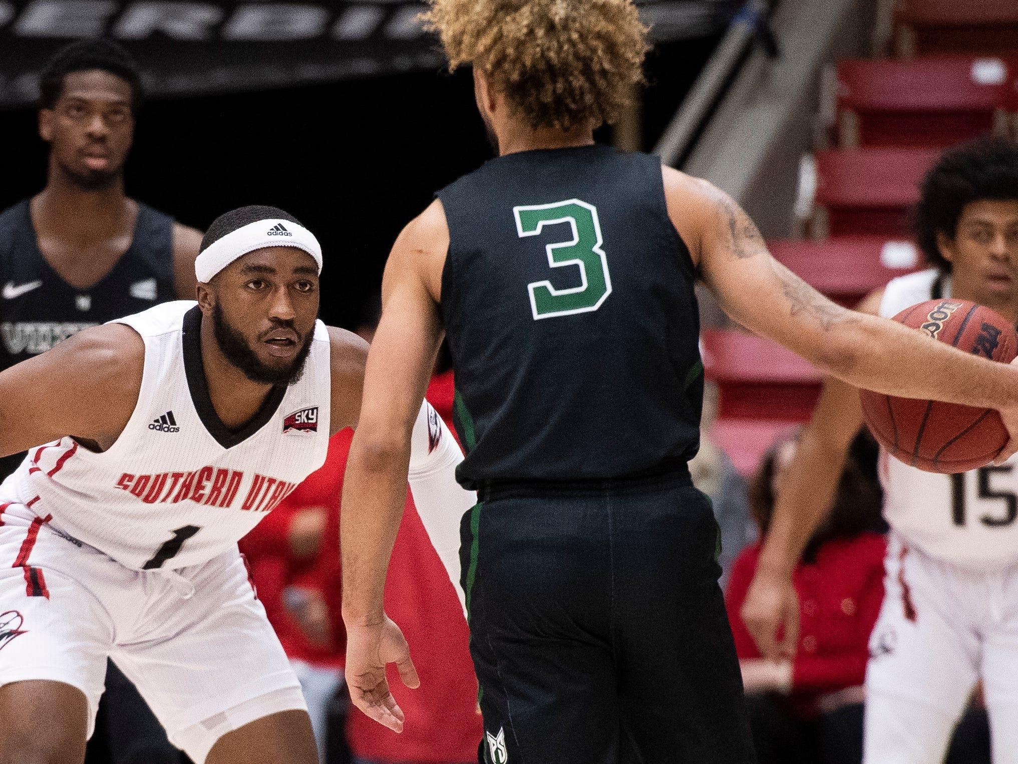 Southern Utah University freshman Kenton Eskridge (1) stares down his Portland State assignment in the America First Event Center Thursday, January 17, 2019. SUU won, 83-69.