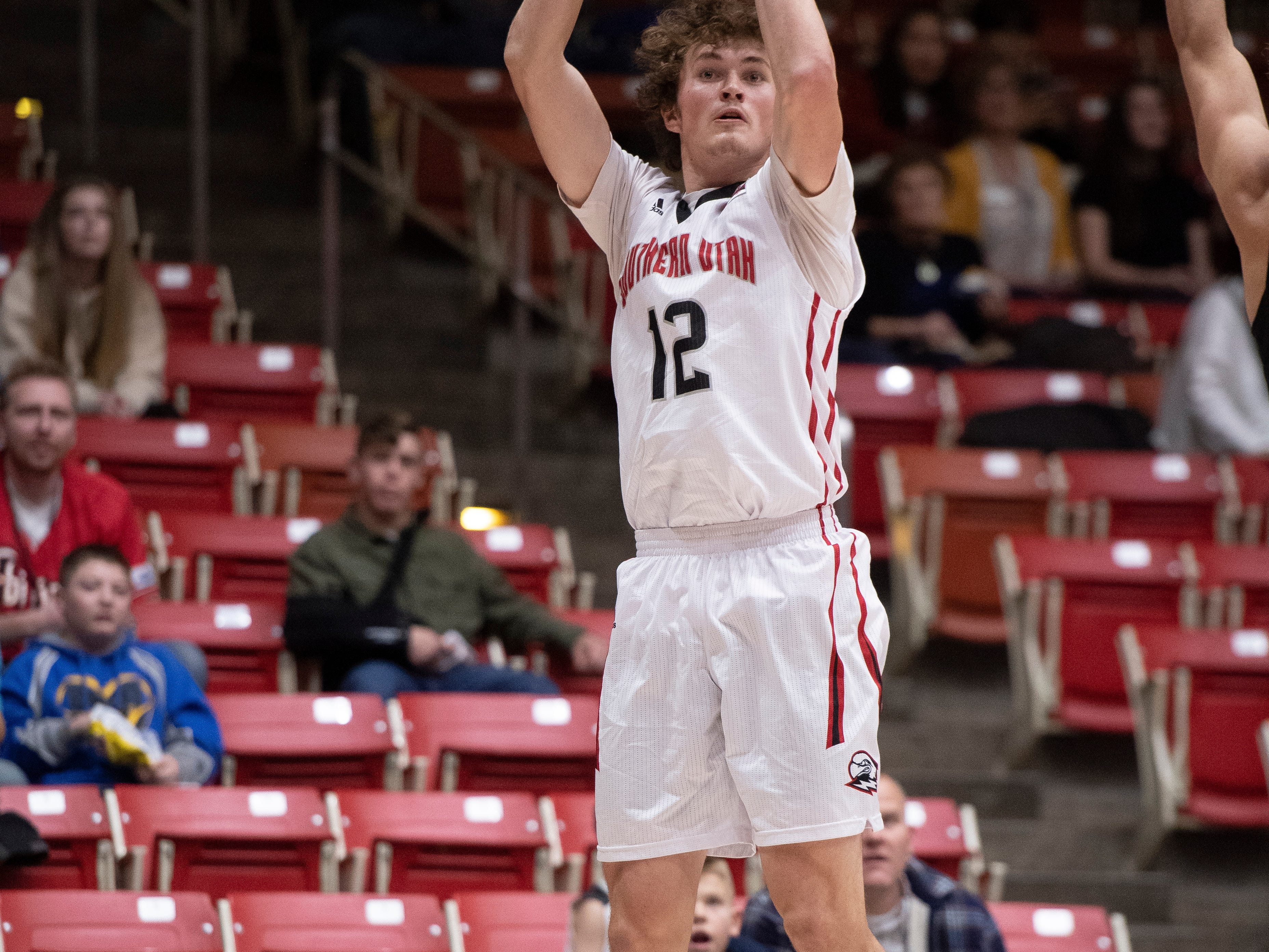 Southern Utah University freshman Maizen Fausett (12) scores three points against Portland State in the America First Event Center Thursday, January 17, 2019. SUU won, 83-69.