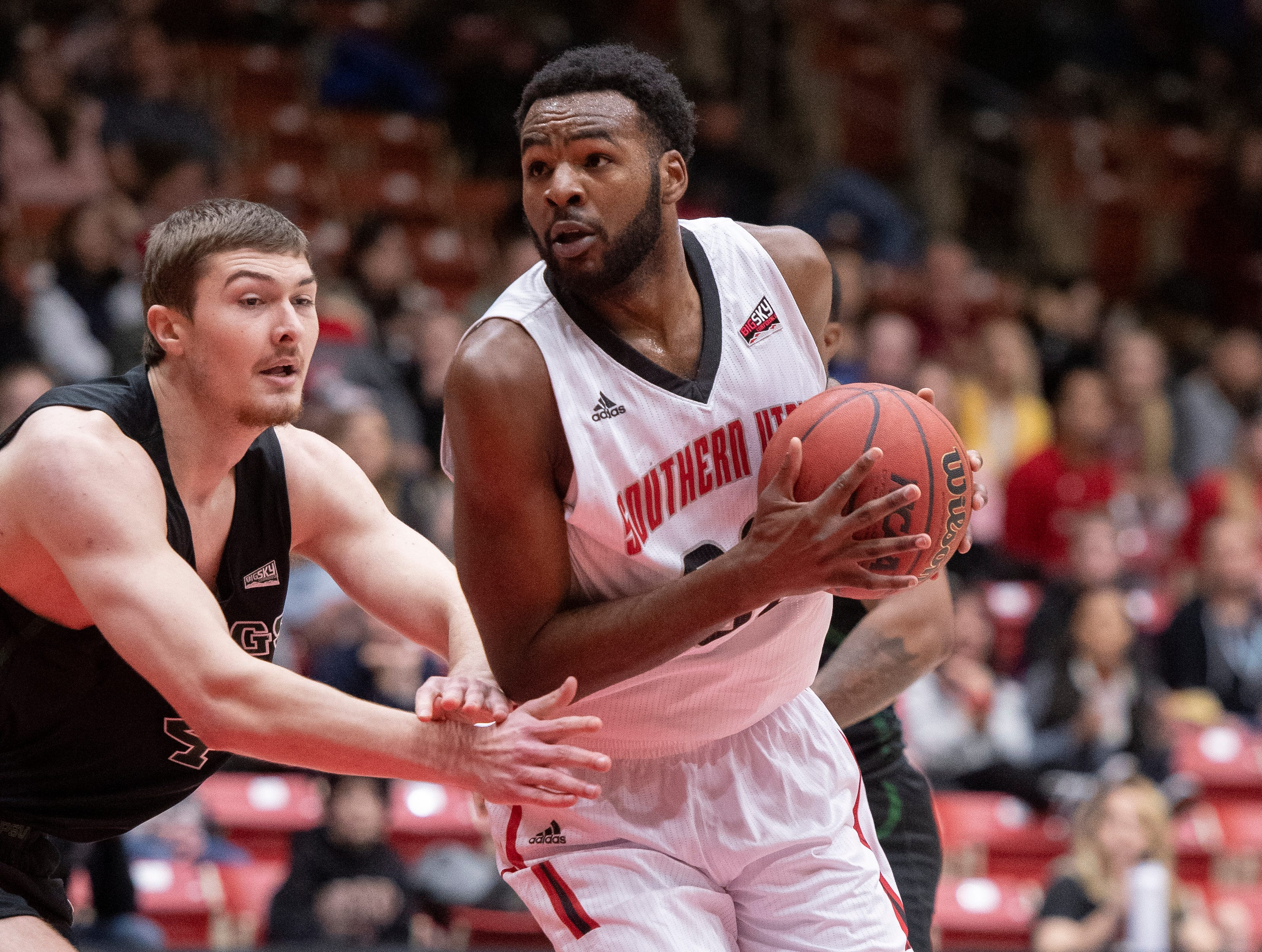 Southern Utah University junior Andre Adams (32) moves into the key against Portland State in the America First Event Center Thursday, January 17, 2019. SUU won, 83-69.