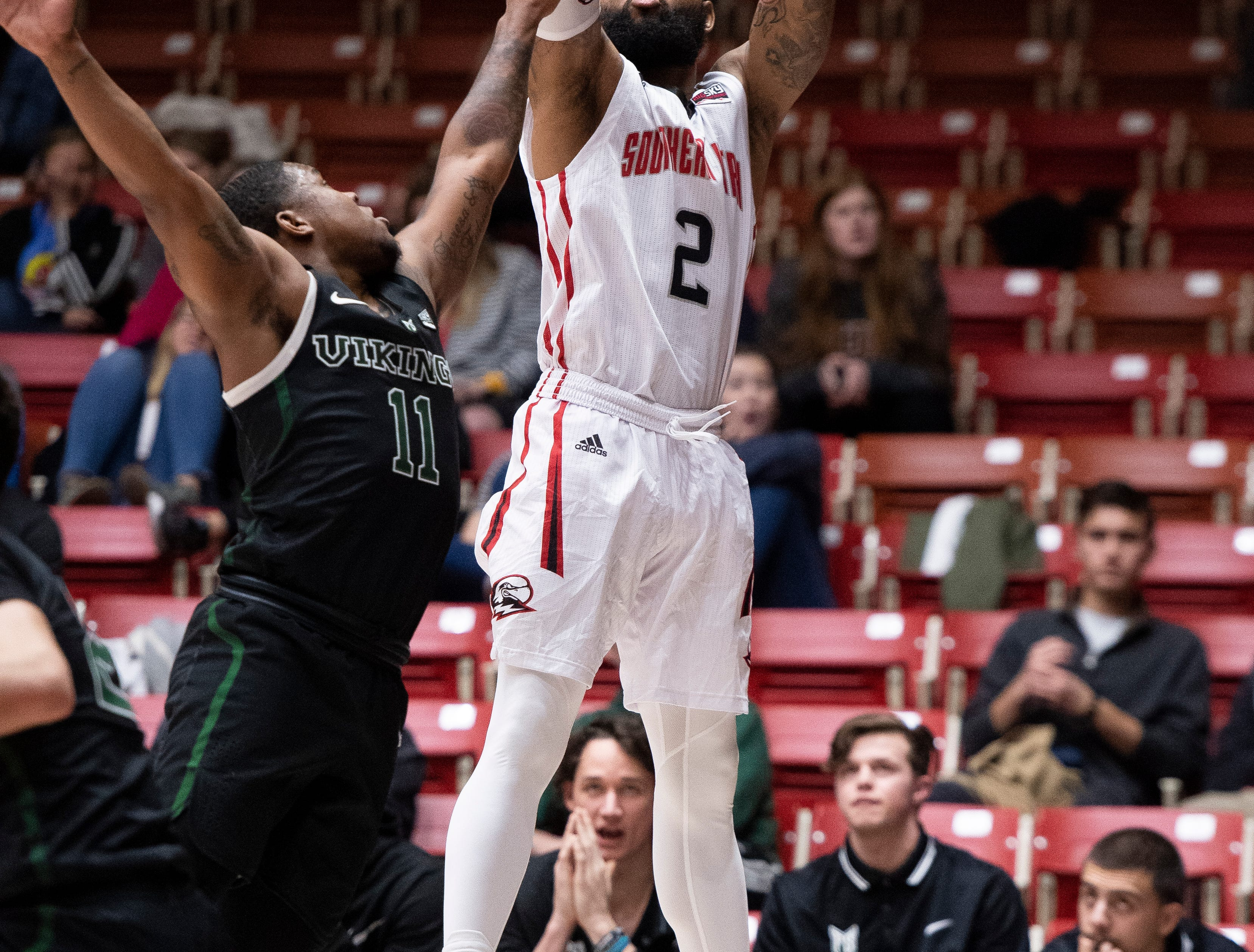 Southern Utah University senior Brandon Better (2) jumps high to sink a three-point basket against Portland State in the America First Event Center Thursday, January 17, 2019. SUU won, 83-69.