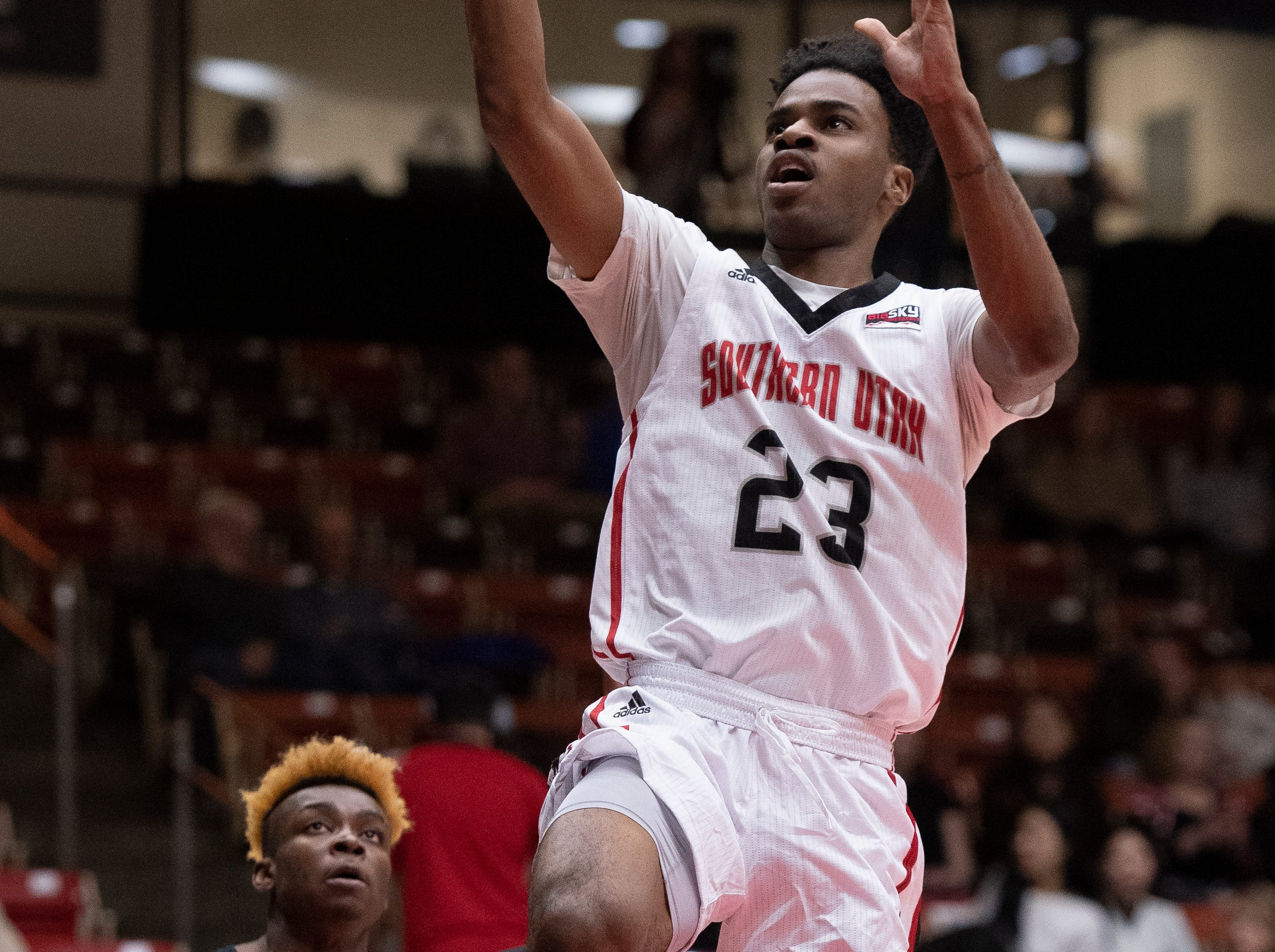 Southern Utah University junior Cameron Oluyitan (23) scores a basket against Portland State in the America First Event Center Thursday, January 17, 2019. SUU won, 83-69.