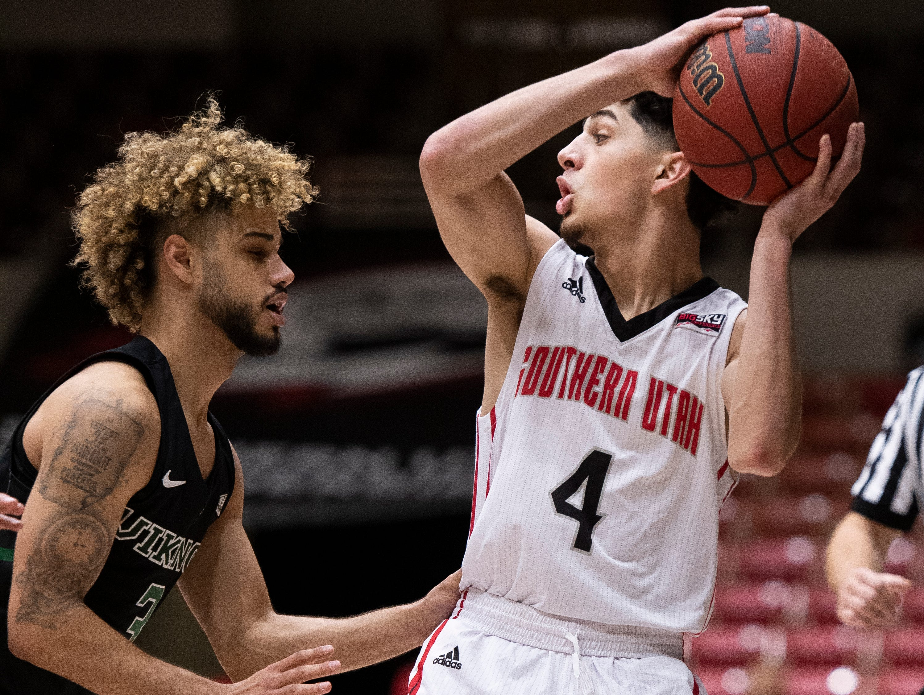 Southern Utah University sophomore Dre Marin (4) looks for options against Portland State in the America First Event Center Thursday, January 17, 2019. SUU won, 83-69.