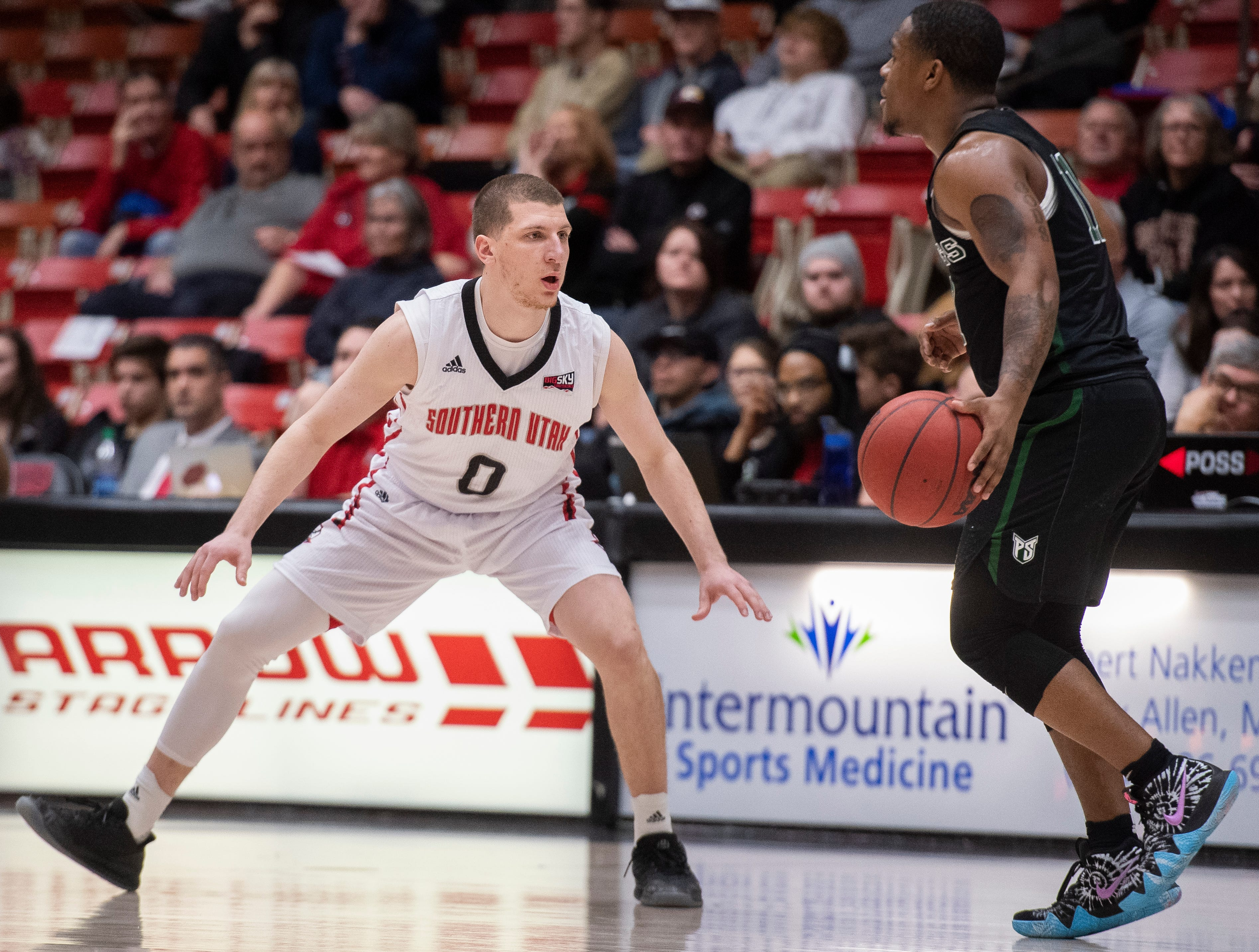 Southern Utah University freshman Dato Aphkhazava (0) defends against Portland State in the America First Event Center Thursday, January 17, 2019. SUU won, 83-69.