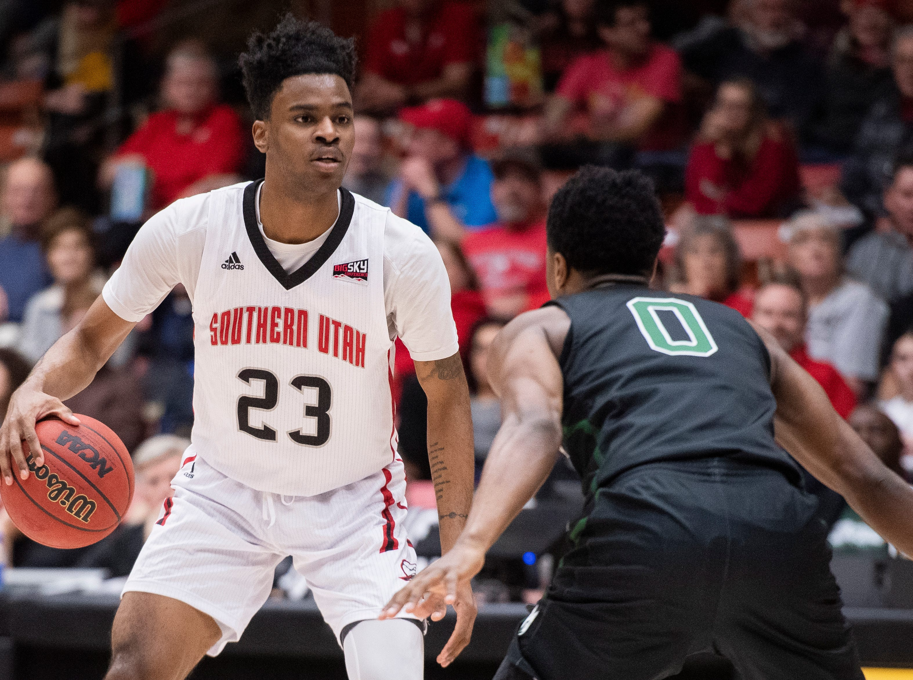 Southern Utah University junior Cameron Oluyitan (23) surveys his options against Portland State in the America First Event Center Thursday, January 17, 2019. SUU won, 83-69.