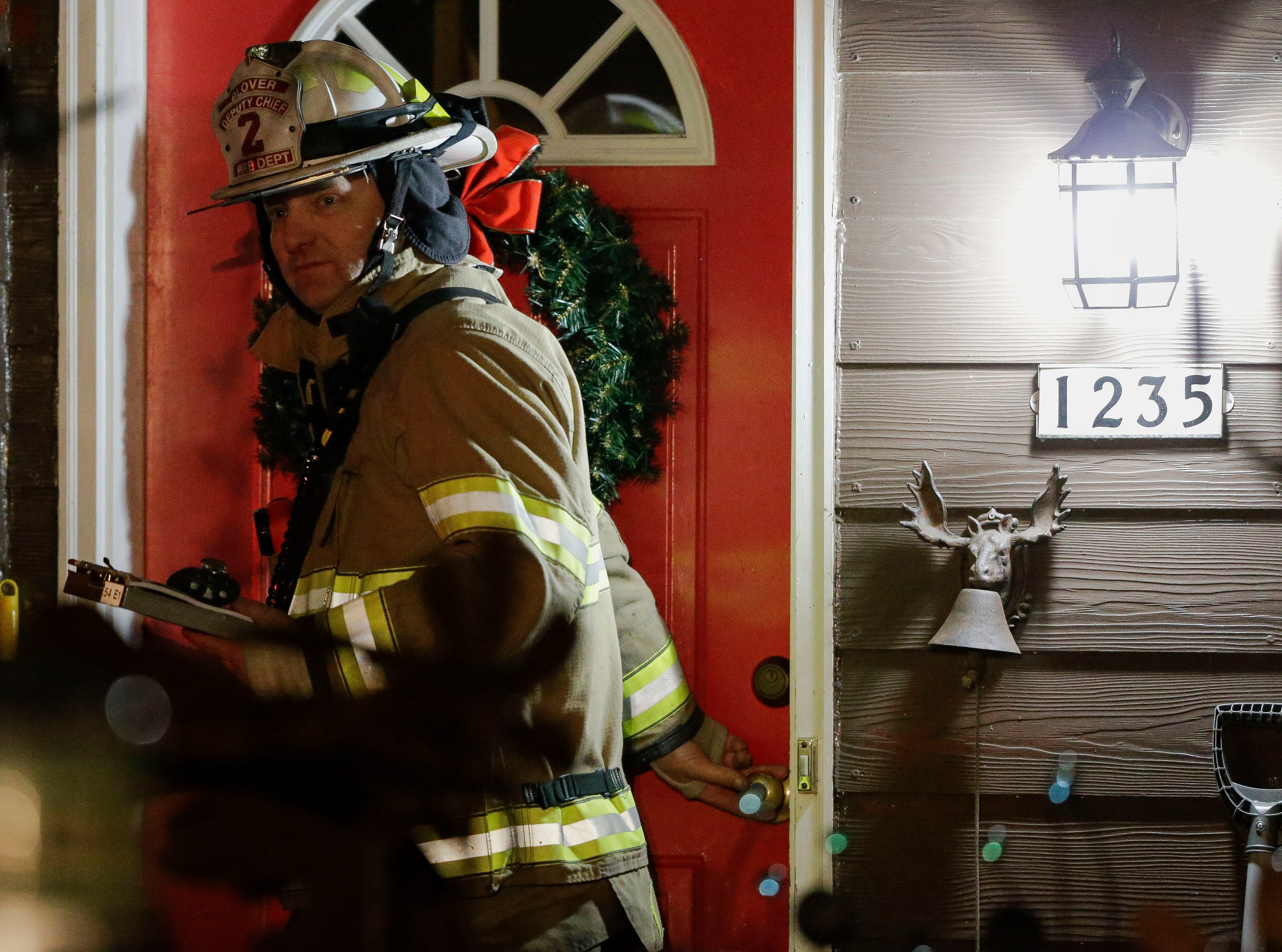 Plover Deputy Fire Chief Ken Voss exits a house on Thursday, January 17, 2019, at 1235 Meehan Ave. outside Plover, Wis. Tork Mason/USA TODAY NETWORK-Wisconsin