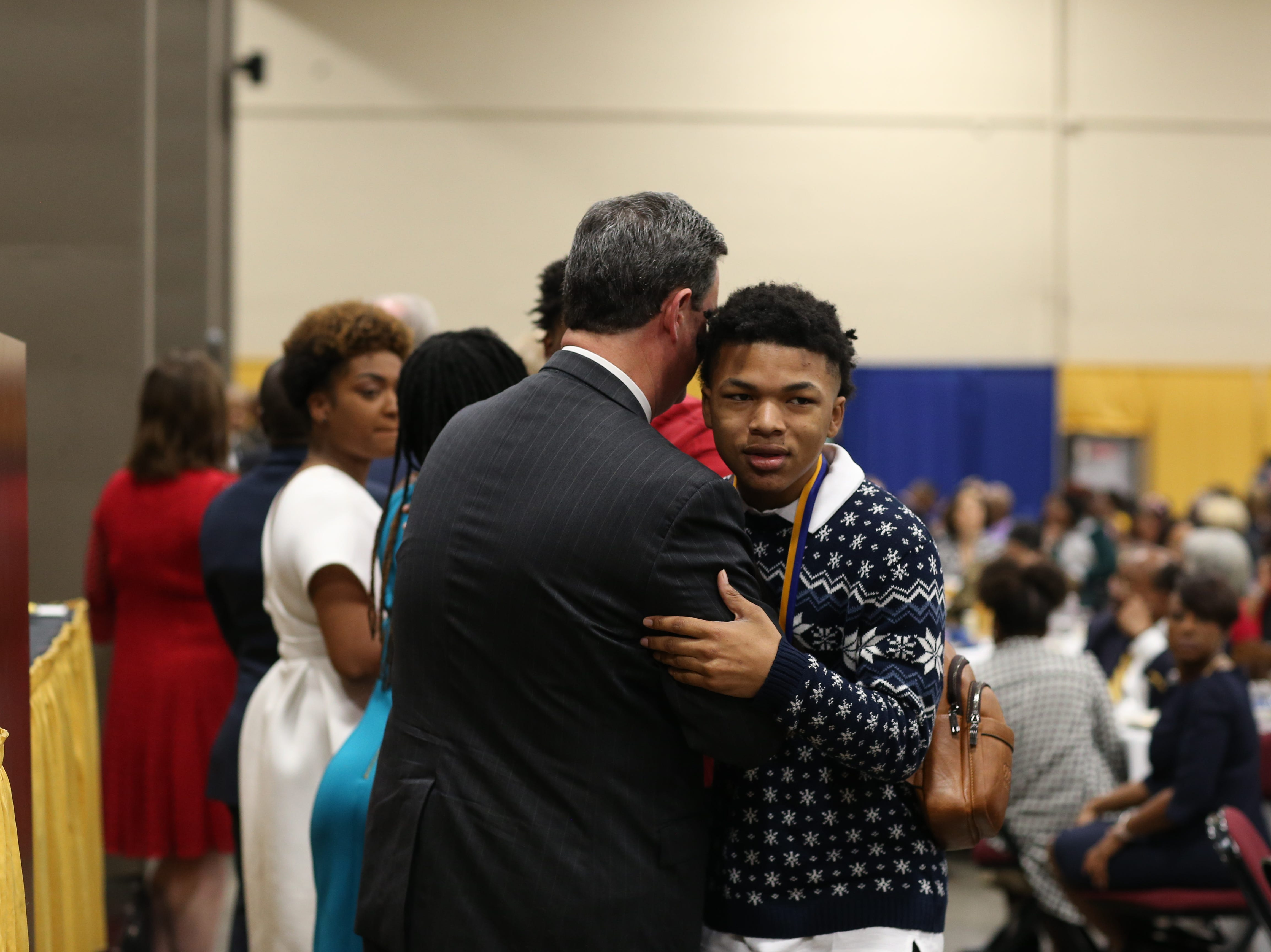 De'Mari Williams, 15, of Success Academy, is congratulated by Mayor John Dailey after receiving a medal during the Martin Luther King Jr. commemorative breakfast at Donald L. Tucker Civic Center Friday, Jan. 18, 2019.