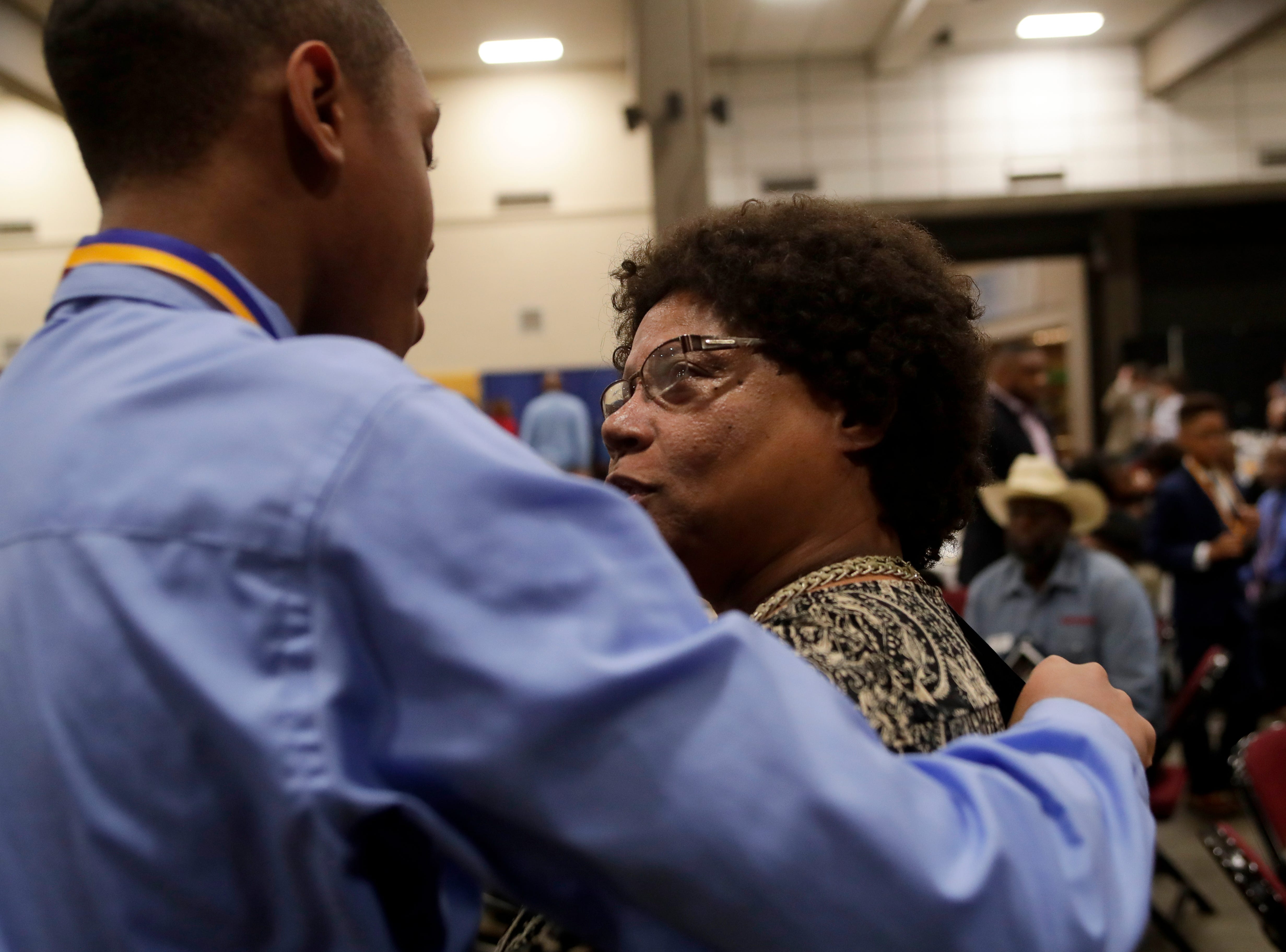 "Dante Dix, 18, a Rickards High School student, is congratulated by his former elementary school teacher Paula Pearcey after he received a medal during the Martin Luther King Jr. commemorative breakfast held at the Donald L. Tucker Civic Center Friday, Jan. 18, 2019. Leon County School students were given medals in recognition for being ""Dreamers and Doers."""