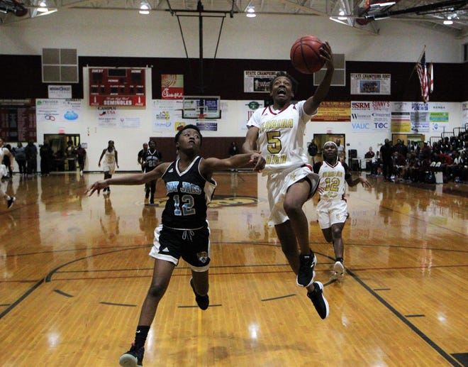 Florida High freshman Tonie Morgan races in for a left-handed layup off a fastbreak as the Seminoles beat Gadsden County 69-53 on Jan. 17, 2019.