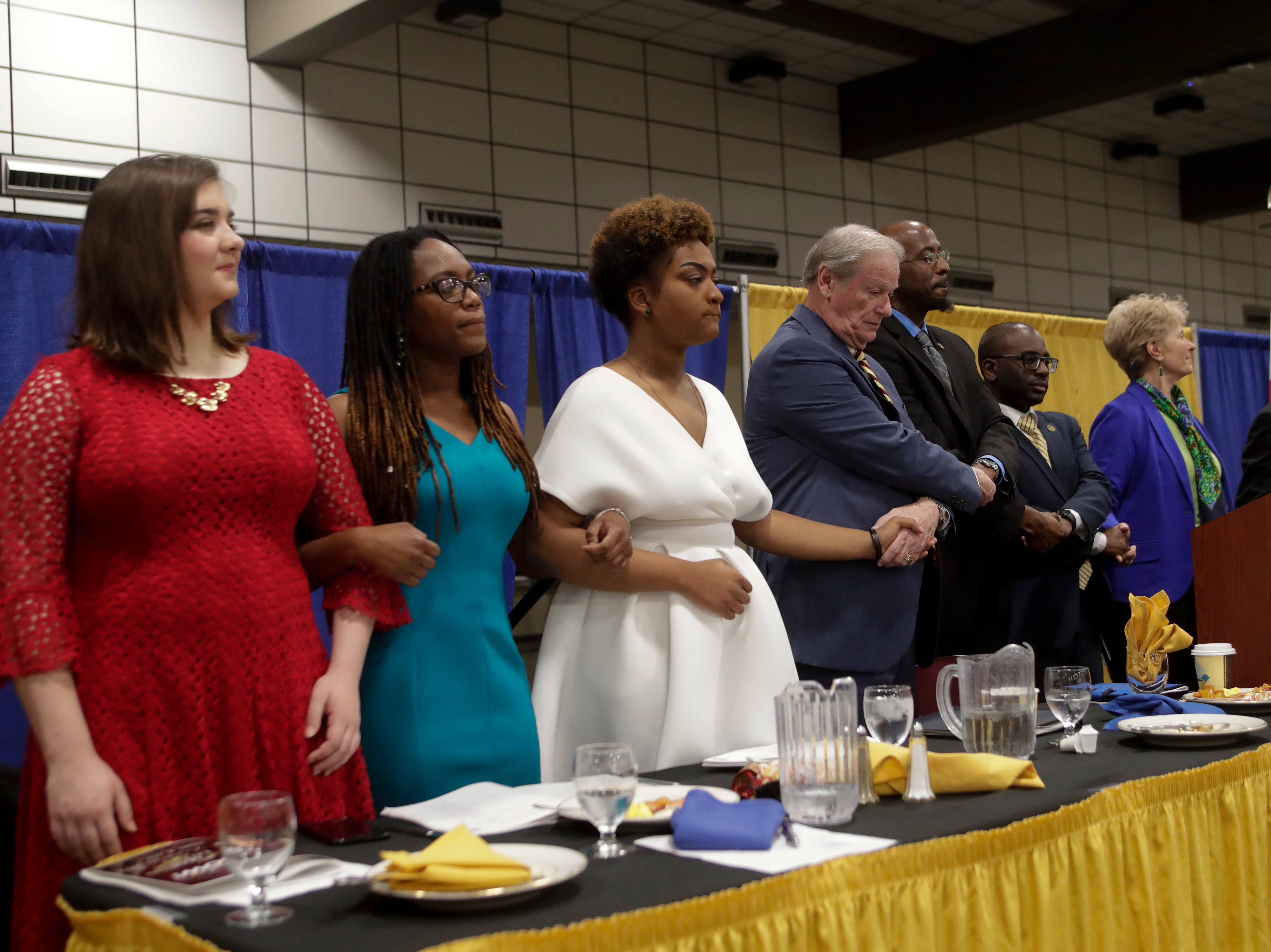 "Attendees lock arms and join in song singing ""We Shall Overcome"" at the end of the Martin Luther King Jr. commemorative breakfast at Donald L. Tucker Civic Center Friday, Jan. 18, 2019."