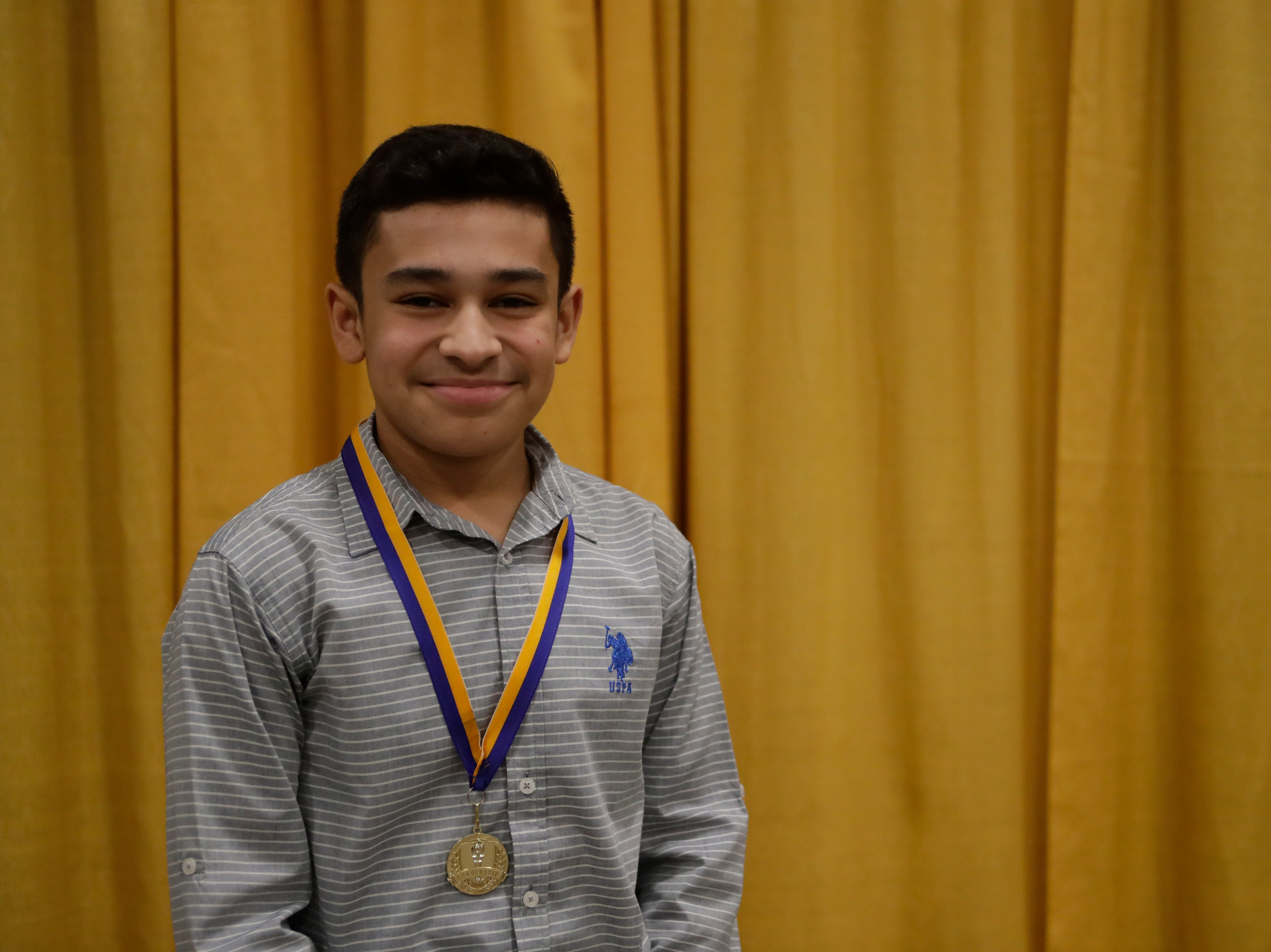 "Eduardo Castillo, a Cobb Middle School eighth grader, received a medal in recognition for being part of the ""Dreamers and Doers"" at the Martin Luther King Jr. commemorative breakfast at Donald L. Tucker Civic Center Friday, Jan. 18, 2019."