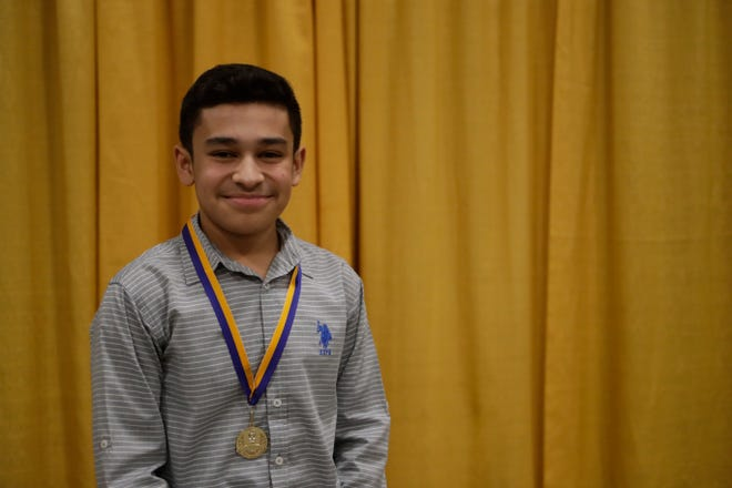"""Eduardo Castillo, a Cobb Middle School eighth grader, received a medal in recognition for being part of the """"Dreamers and Doers"""" at the Martin Luther King Jr. commemorative breakfast at Donald L. Tucker Civic Center Friday, Jan. 18, 2019."""