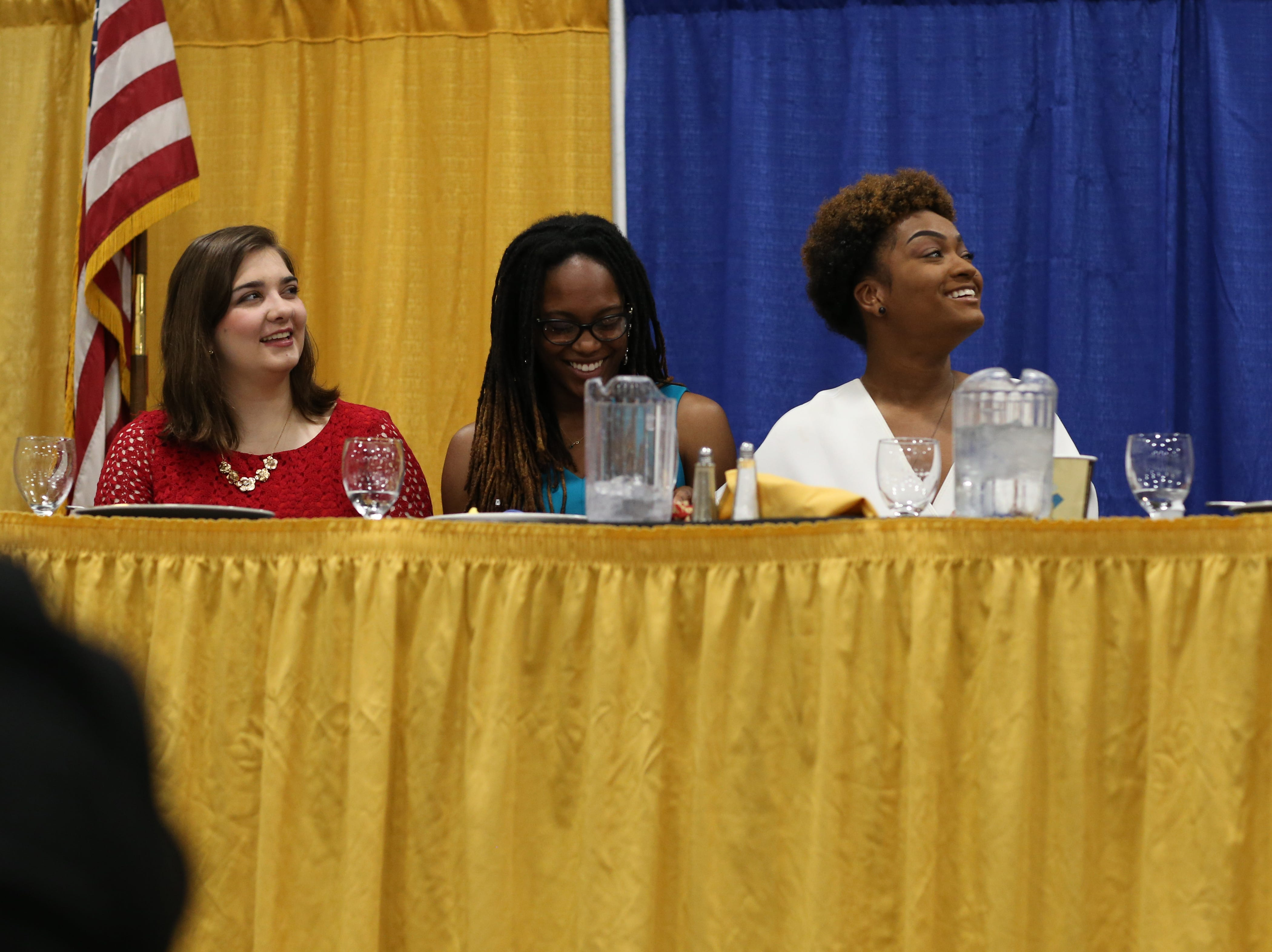 Leon County School Board Student Member Ashley Campbell, left, Florida A&M University NAACP Chapter President Joanna Atkinson and Florida State University NAACP Chapter President Nastassia Janvier listen as FSU President John Thrasher speaks during the Martin Luther King Jr. commemorative breakfast at Donald L. Tucker Civic Center Friday, Jan. 18, 2019.