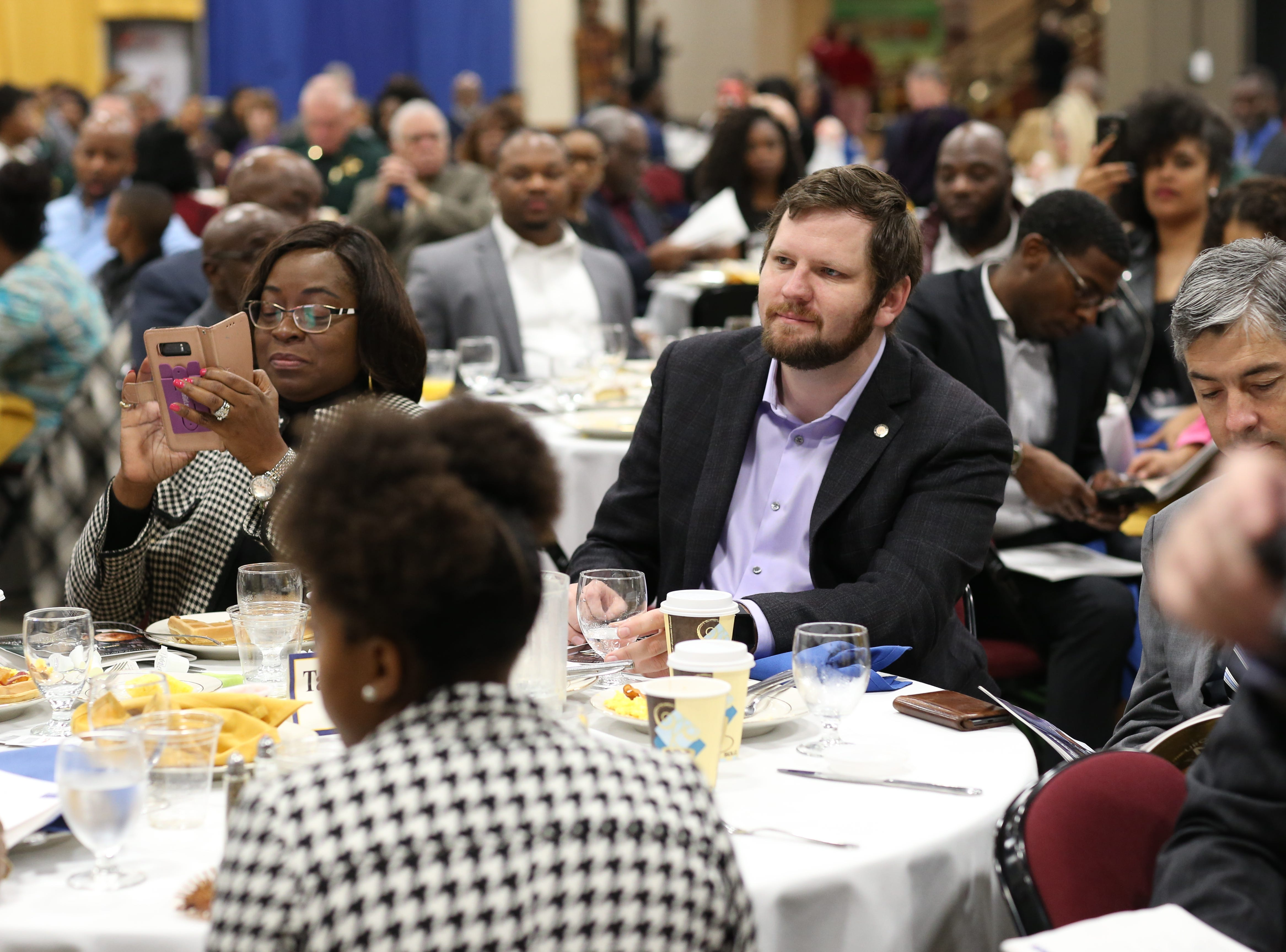 City Commissioners Dianne Williams-Cox and Jeremy Matlow listen as DETROITLIVE performs during the Martin Luther King Jr. commemorative breakfast at the Donald L. Tucker Civic Center Friday, Jan. 18, 2019.