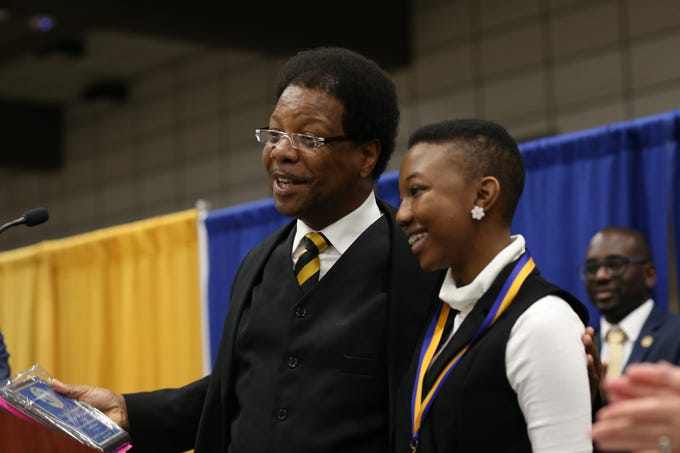 Florida High's Asia Nicole Alexander, 16, receives the MLK Foundation Scholarship of Florida during the Martin Luther King Jr. commemorative breakfast Friday, Jan. 18, 2019.