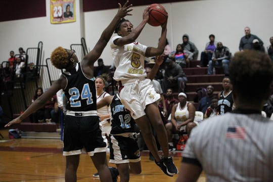 Florida High freshman Tonie Morgan hangs in the air for a left-handed layup as the Seminoles beat Gadsden County 69-53 on Jan. 17, 2019.