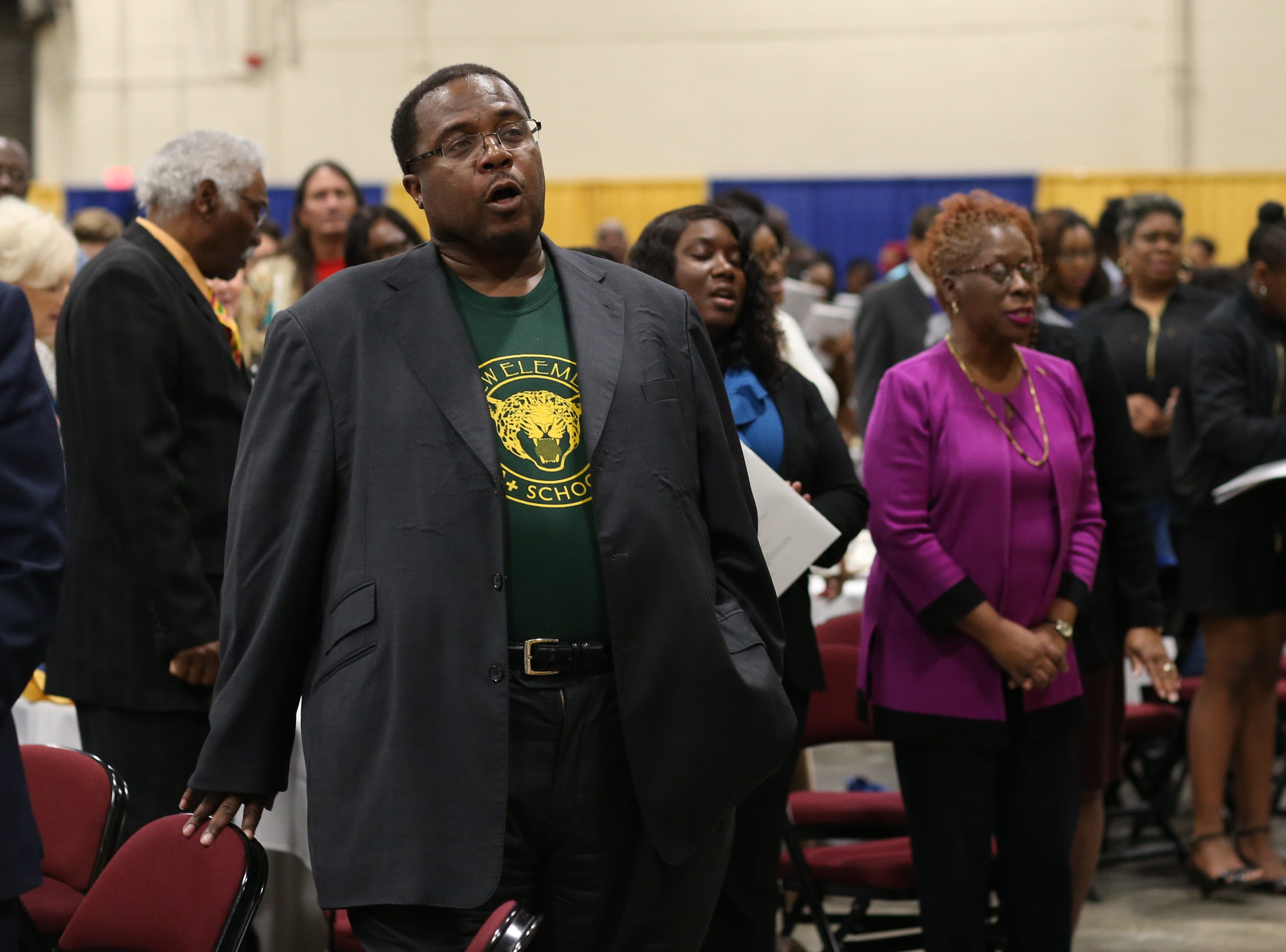 "Leon County School Board Member Darryl Jones sings along to the Negro National Anthem ""Lift Every Voice and Sing"" played during the Martin Luther King Jr. commemorative breakfast at Donald L. Tucker Civic Center Friday, Jan. 18, 2019."
