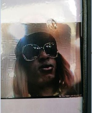 Quincy Police are looking for a suspect who robbed a bank while disguised as a woman on Friday. Police say the man has a distinctive chin.