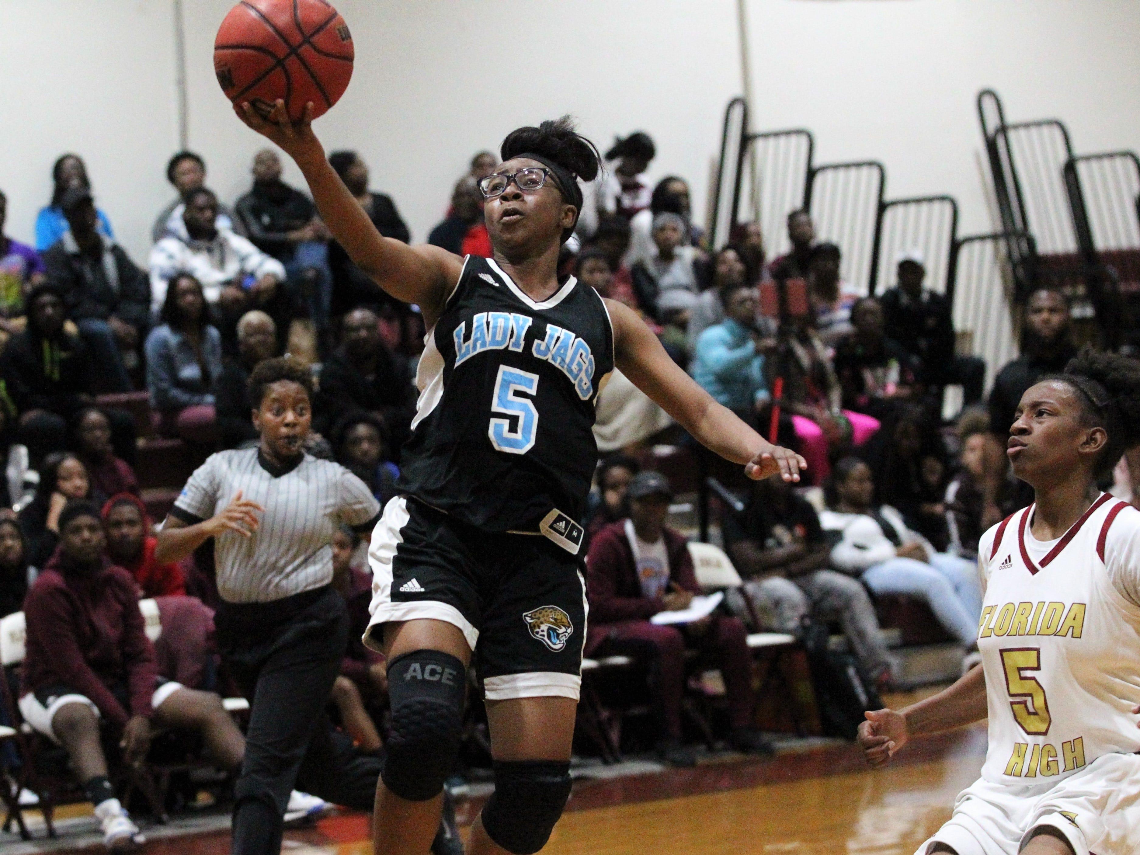Gadsden County point guard Ta'Nija Watson scoops a layup as Florida High beat Gadsden County 69-53 on Jan. 17, 2019.