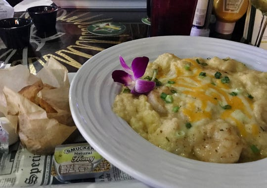 2nd Street Bistro's Shrimp and Grits had jumbo shrimp swimming in rich, cheesy, creamy grits.