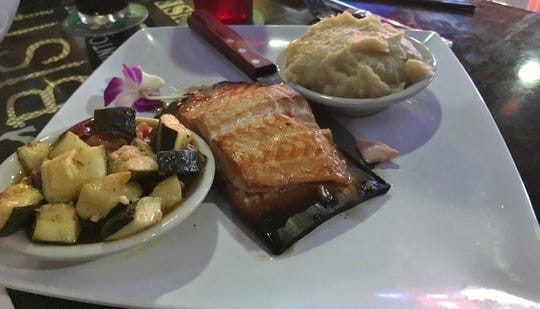 2nd Street Bistro Salmon is baked on a cedar plank and topped with pear maple glaze.