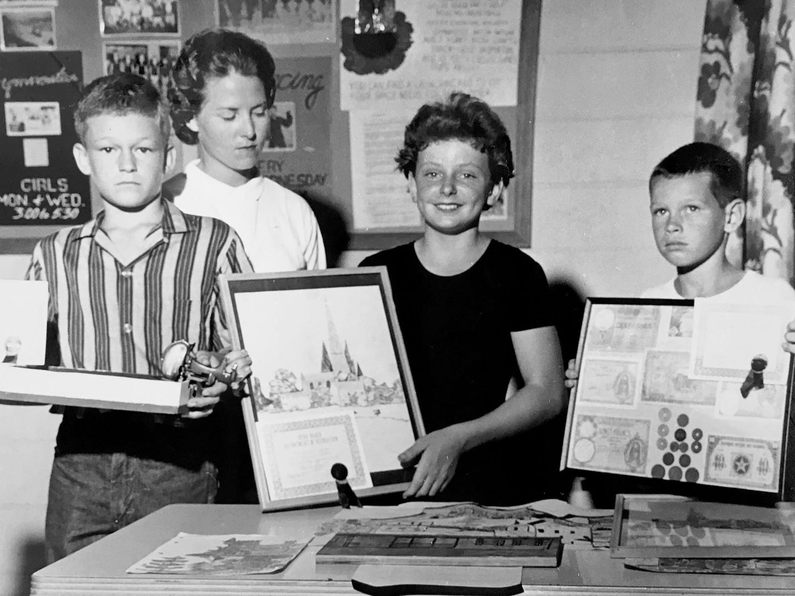 Douglas McPherson, Gwen Loy (judge), Janice Porter and Arthur Weeks show off their winning entires in some type of a contest, unknown year.