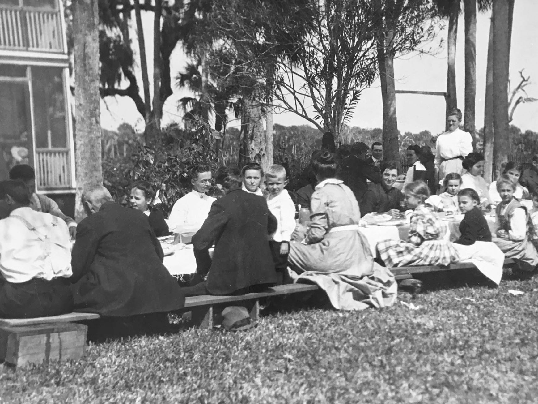 A meal was enjoyed on the lawn of the A.B. Michael home, unknown year.