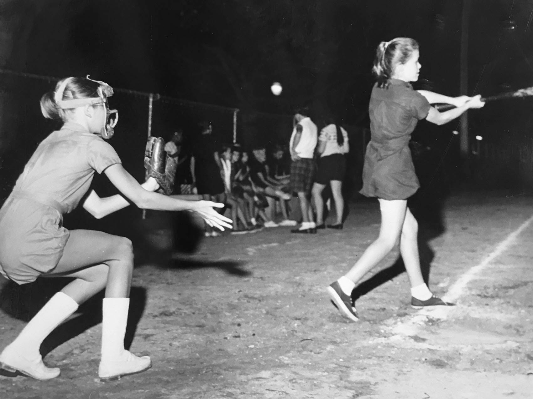 Catcher for the Warrington team, Susan Lloyd, and batter for the Miracle Mile team Mary Anne Roberts play softball in Vero Beach, unknown year.