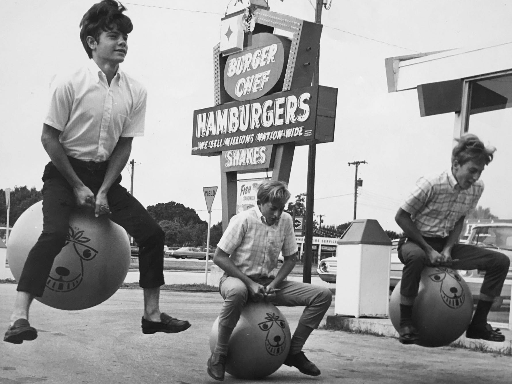 "These boys seem to have more than hamburgers on their minds in 1969 as they bounce past the old Burger Chef on Miracle Mile in Vero Beach. Their antics typified the ""Pogoball"" craze that was the rage at the time."