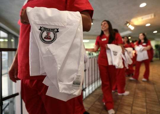 The Gayle Greve Hunt School of Nursing held their first ever white coat ceremony in January for more than 70 students entering the program. Students recited the Florence Nightingale Pledge to end the ceremony.