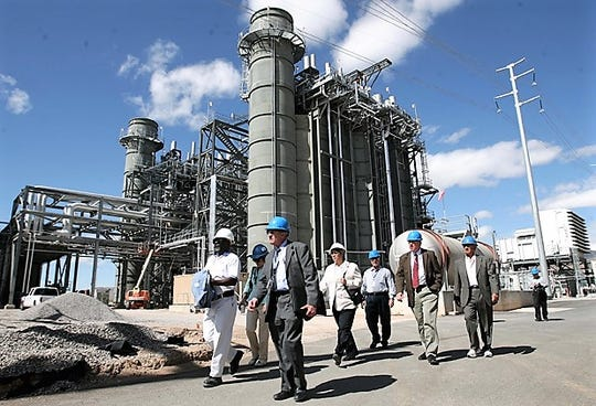 El Paso Electric officals conduct a tour in May 2011 of the $234 million generating-unit addition at the Newman Generating Station in Northeast El Paso. The utility plans to add an $143 million generating unit to the plant by 2023.