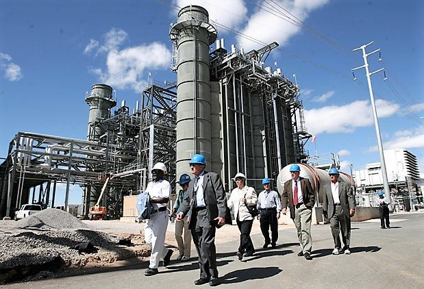 El Paso Electric officials conduct a tour in May 2011 of a $234 million generating-unit addition at the Newman Generating Station in Northeast El Paso. The utility wants to spend $164 million to add another generator to the plant by 2023.